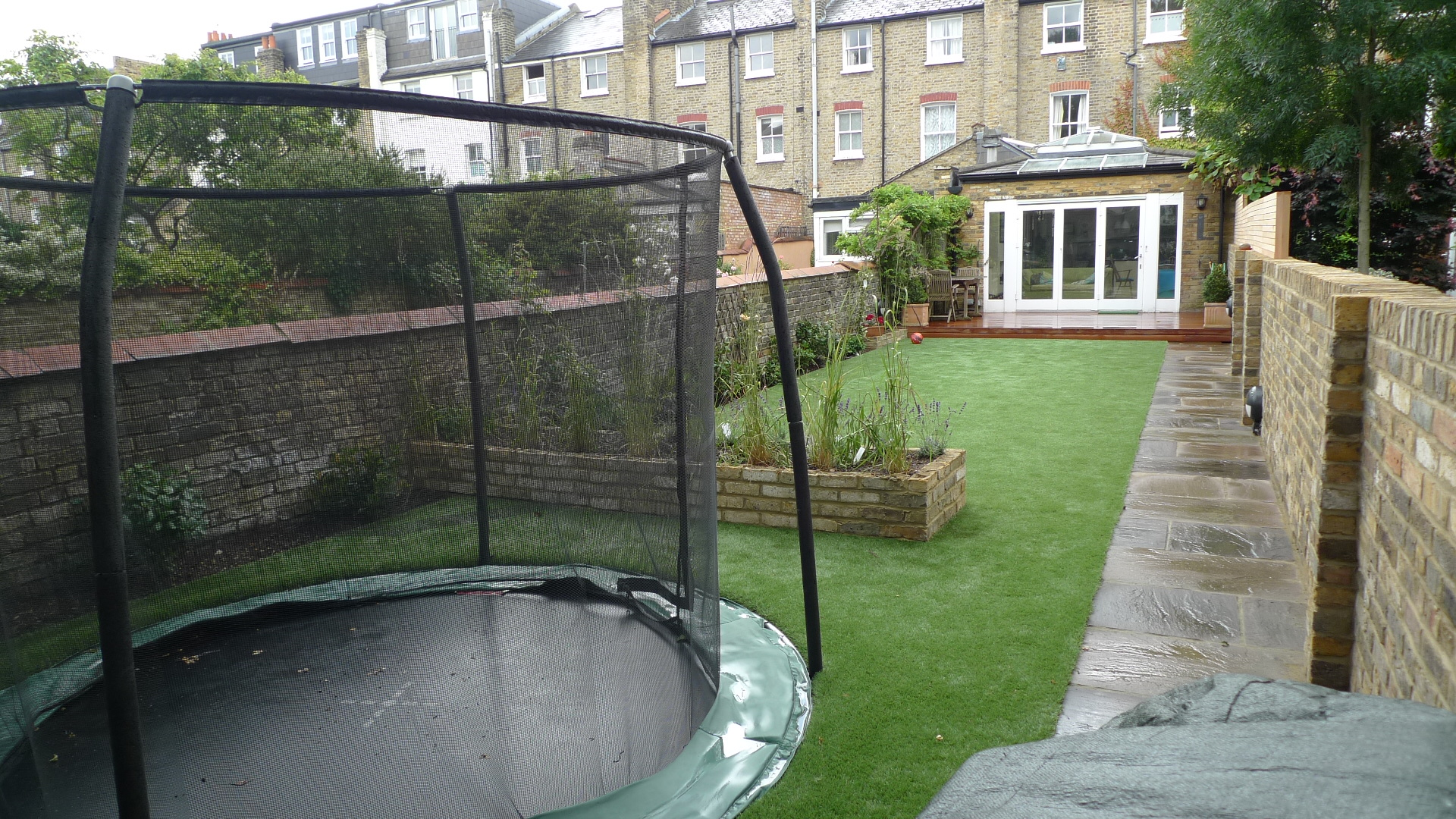 Hardwood Decking Artificial Easy Grass Lawn Sunken Trampoline Balham London (3)