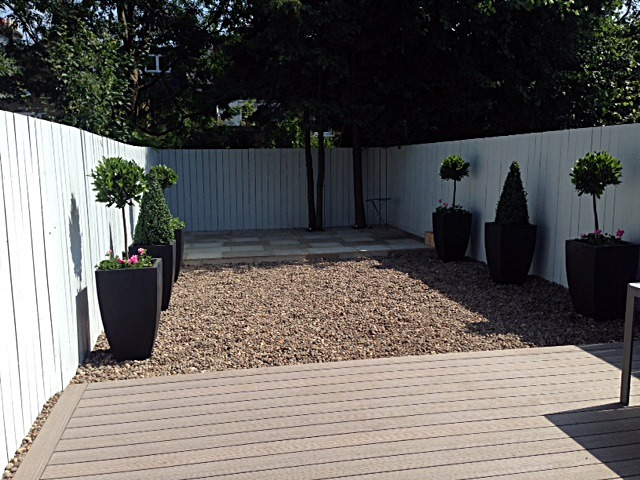 composite decking sawn sandstone paving scottish pebbles modern low maintenance garden design clapham london