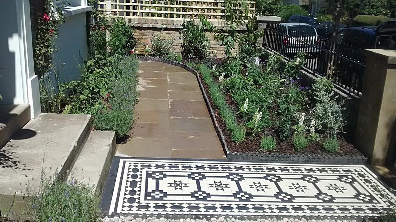 sandstone paving victorian mosaic tile path informal front garden planting scheme london