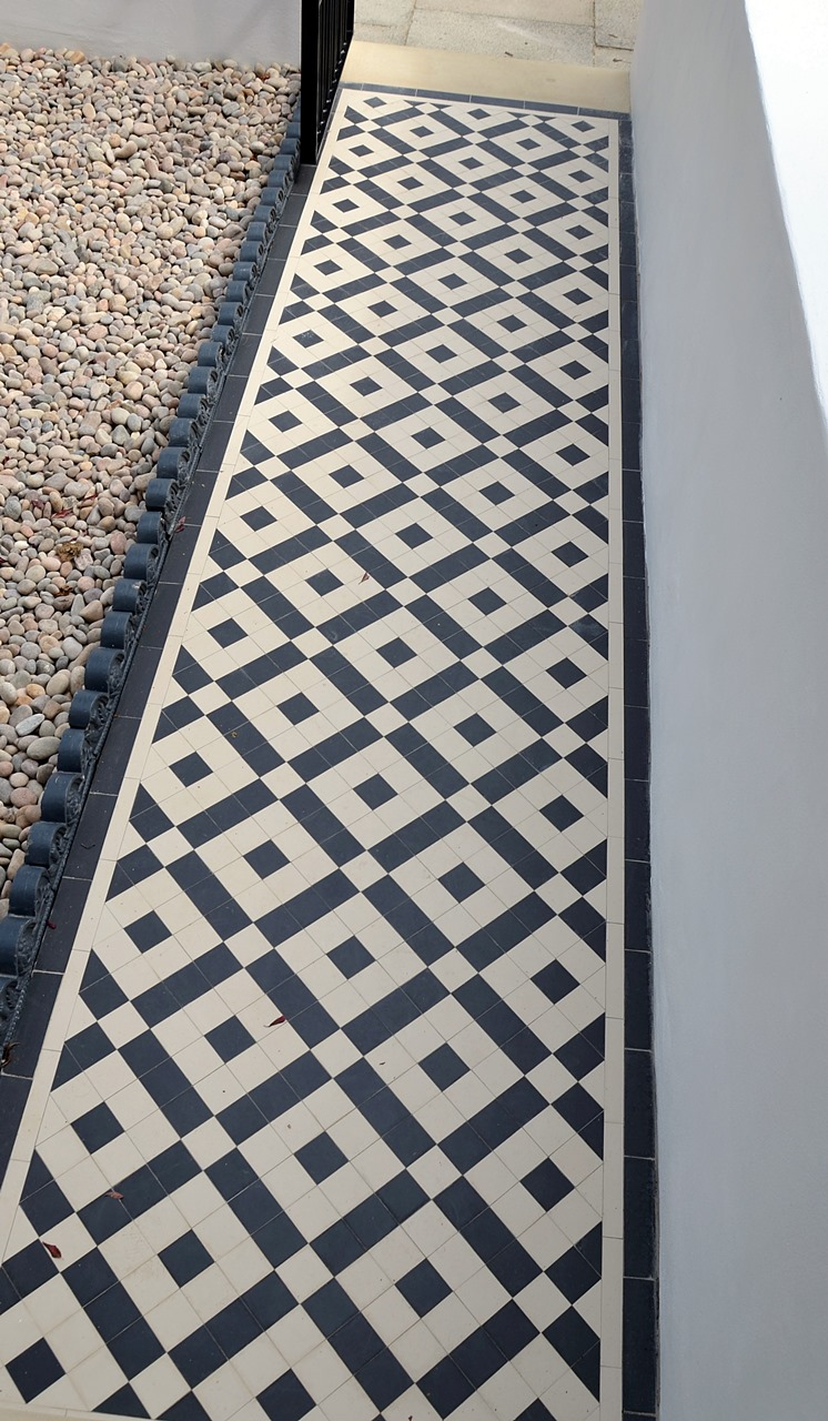 Plastered rendered front garden wall painted white metal wrought iron rail and gate victorian mosaic tile path in black and white scottish pebbles York stone balham london (56)