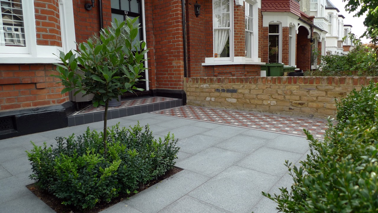 bay tree and topiary with granite paving and victorian mosaic tile path wimbledon london