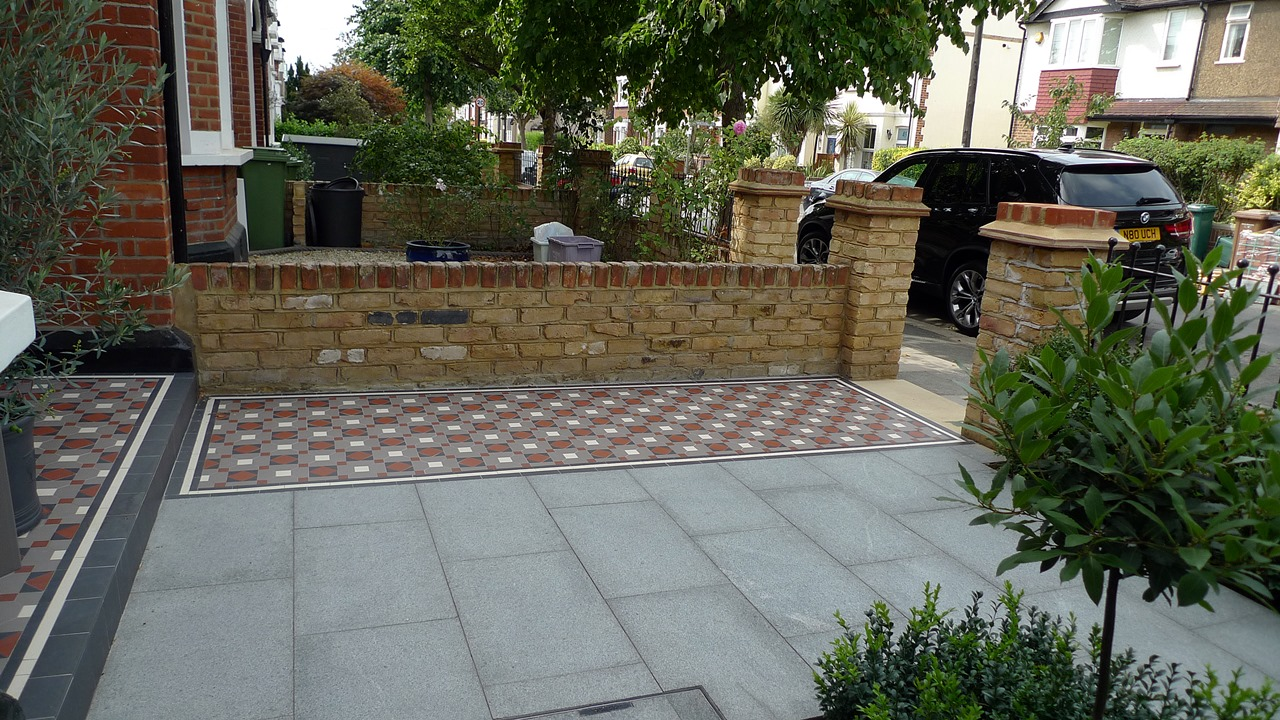 front garden wall mosaic tile path granite paving topiary london