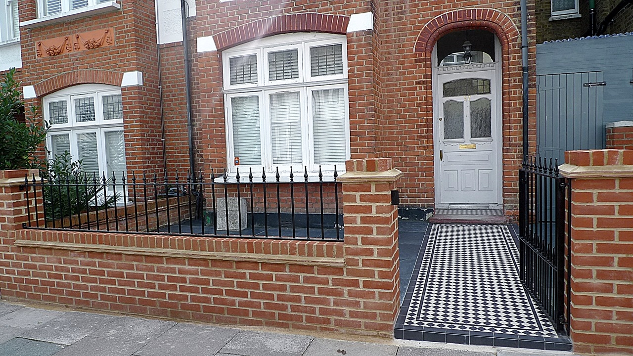red imperial london brick wall blue black slate paving black and white victorian mosaic tile path metal rail and gate (3)