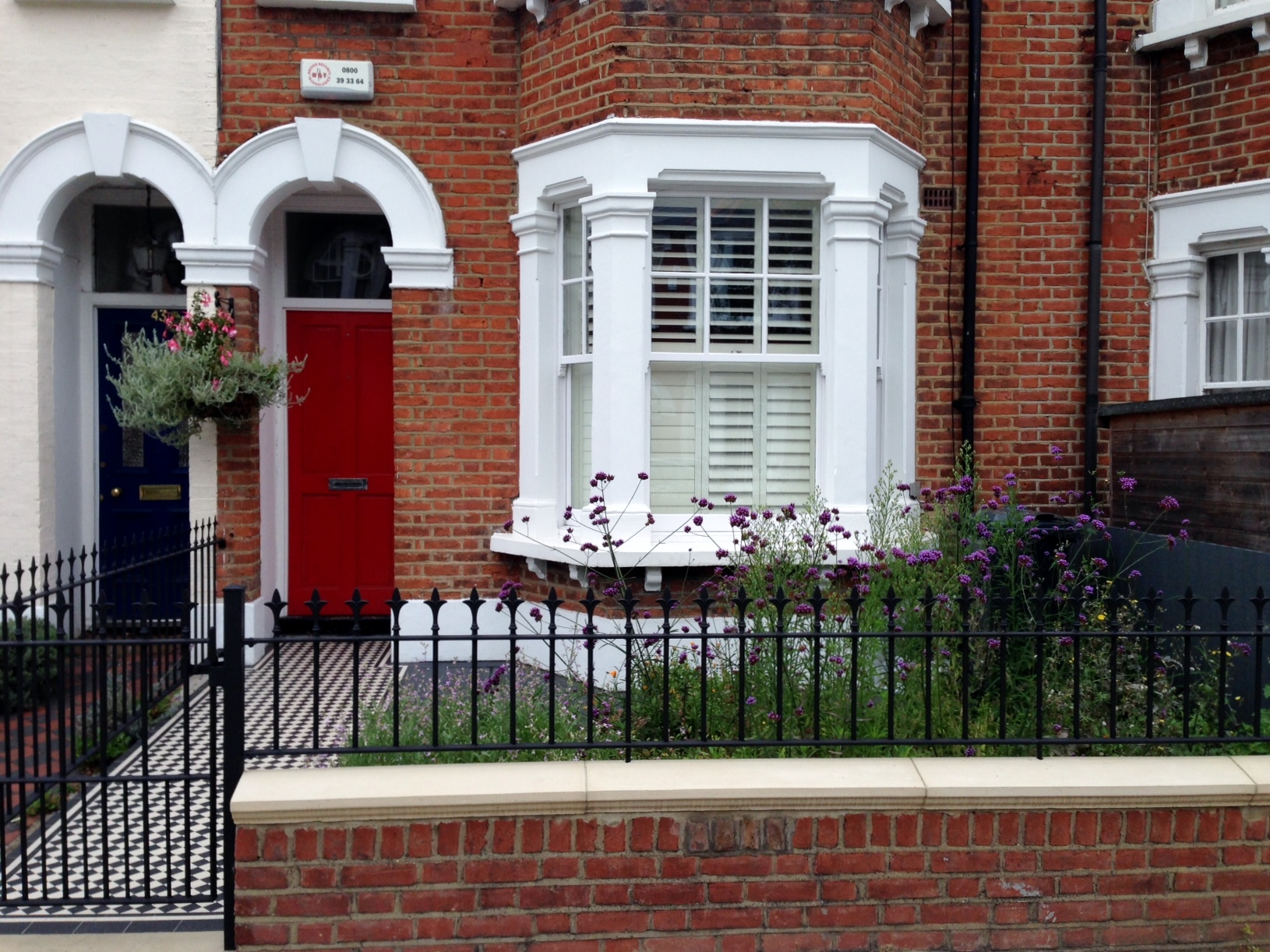front garden brick wall with caps and rails london