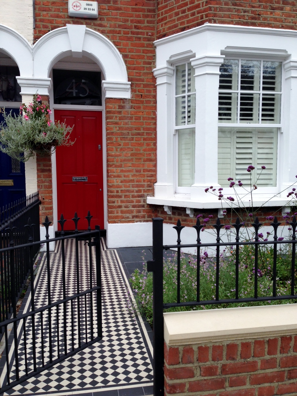 red garden brick wall london rail and gate victorian black and white mosaic tile path balham london (2)