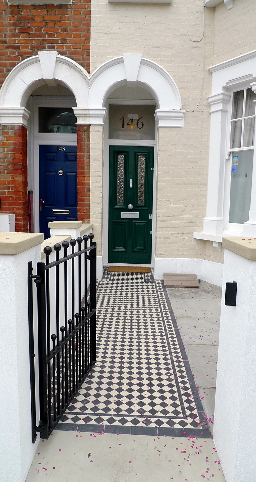 render plaster block wall with yorkstone caps wrought iron rail grey sandstone paving and black and white victorian mosaic tile path balham london (1)