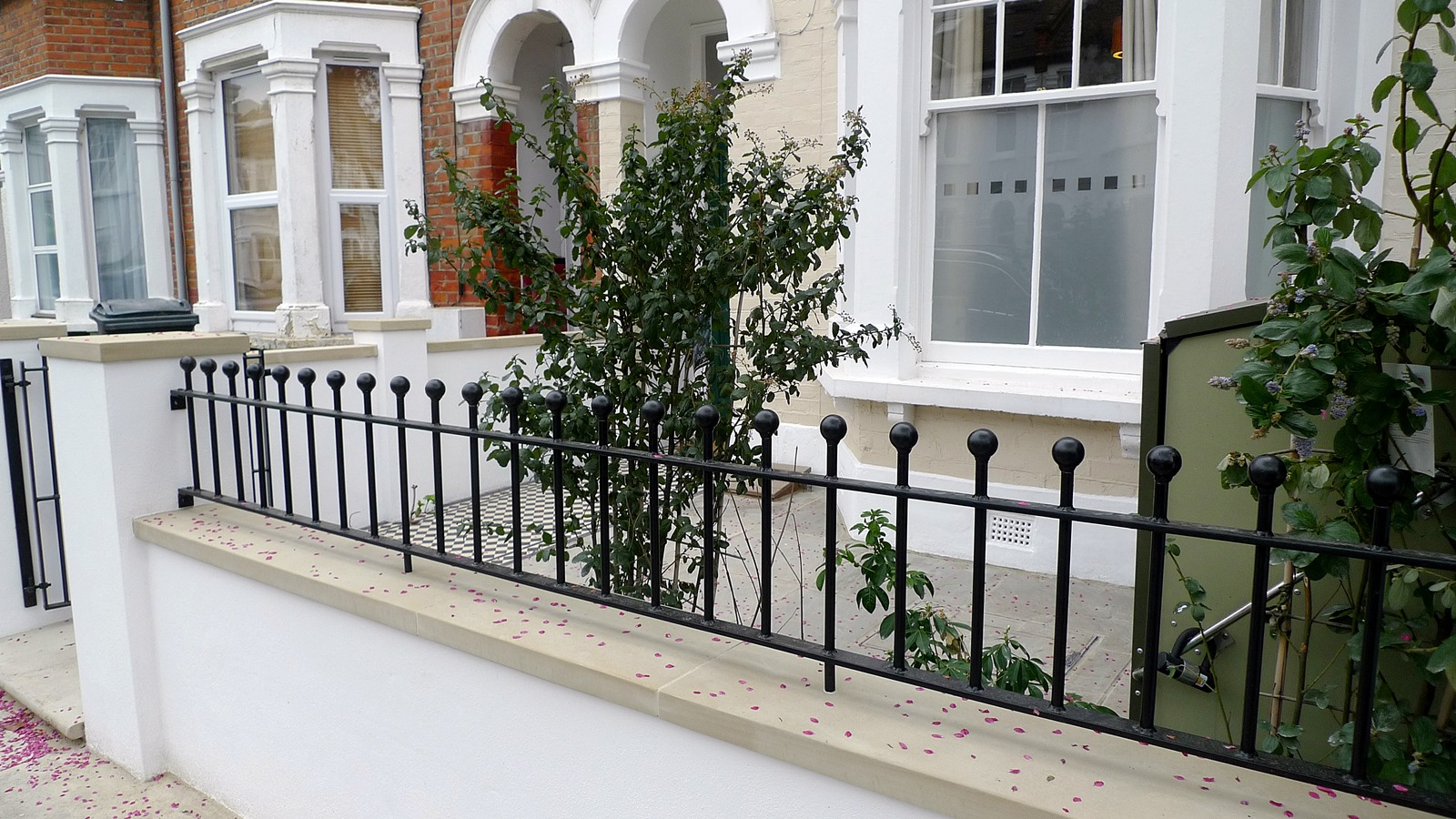 render plaster block wall with yorkstone caps wrought iron rail grey sandstone paving and black and white victorian mosaic tile path balham london (4)