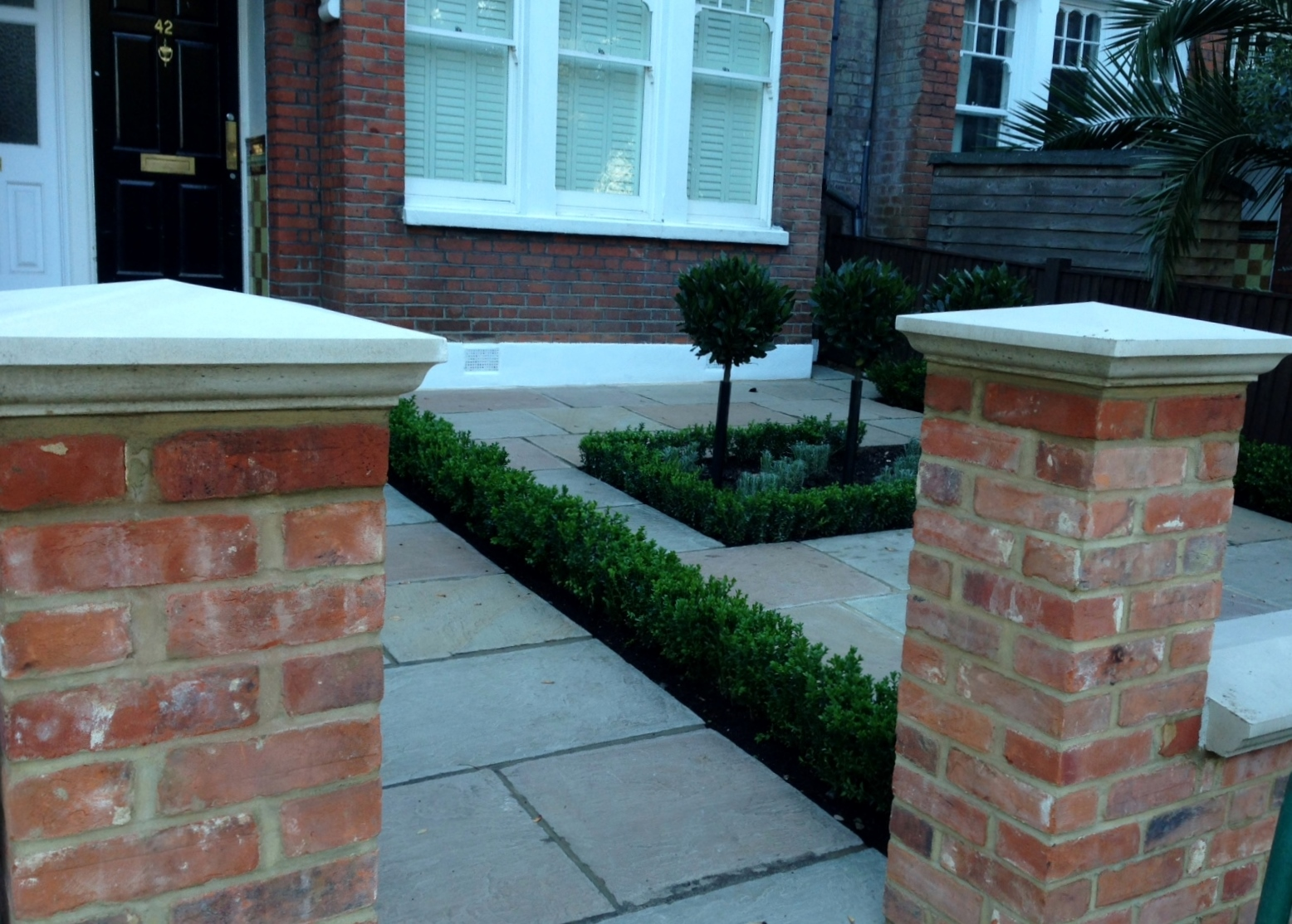 Imperial red brick London wall stone  pier caps sandstone paving and formal topiary classic front garden Balham (1)