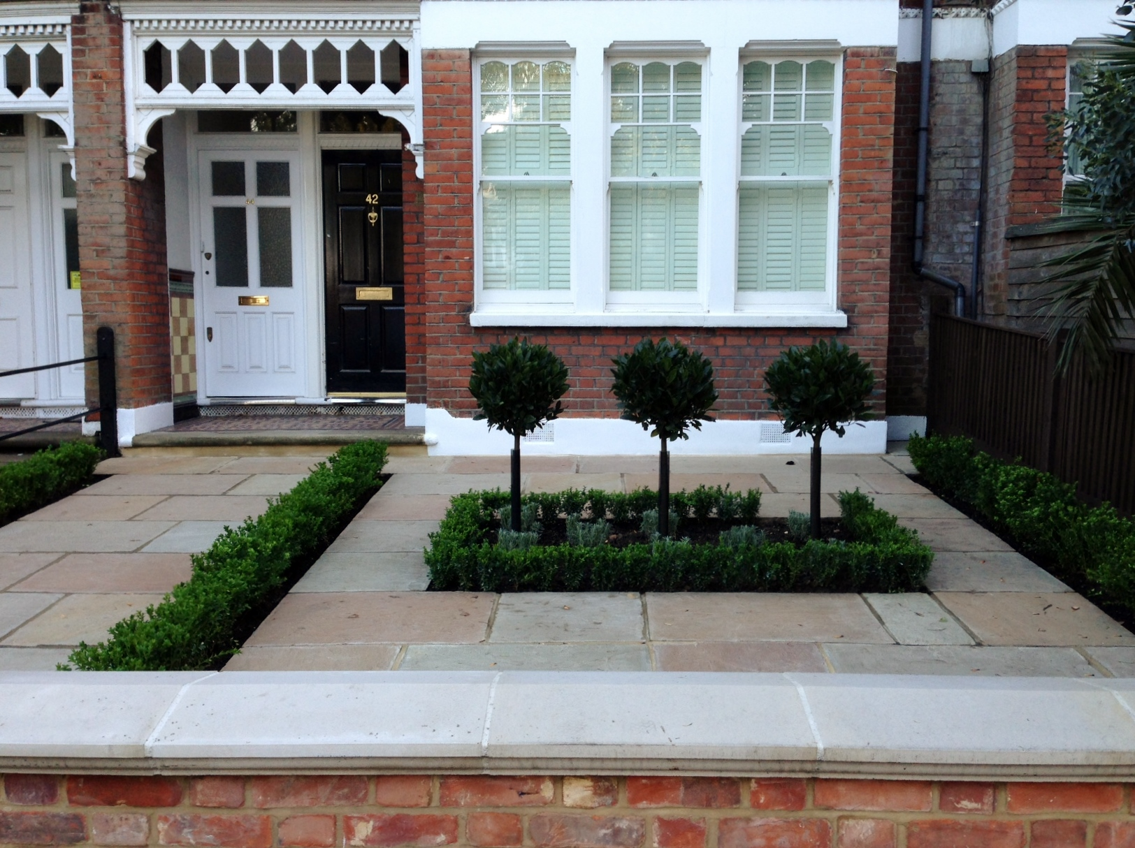 Imperial red brick London wall stone pier caps sandstone paving and formal topiary classic front garden Balham (10)