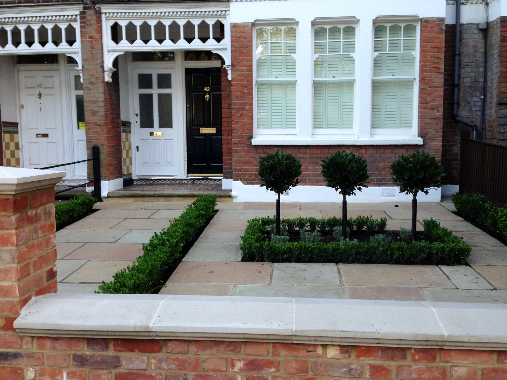 Imperial red brick London wall stone pier caps sandstone paving and formal topiary classic front garden Balham (11)