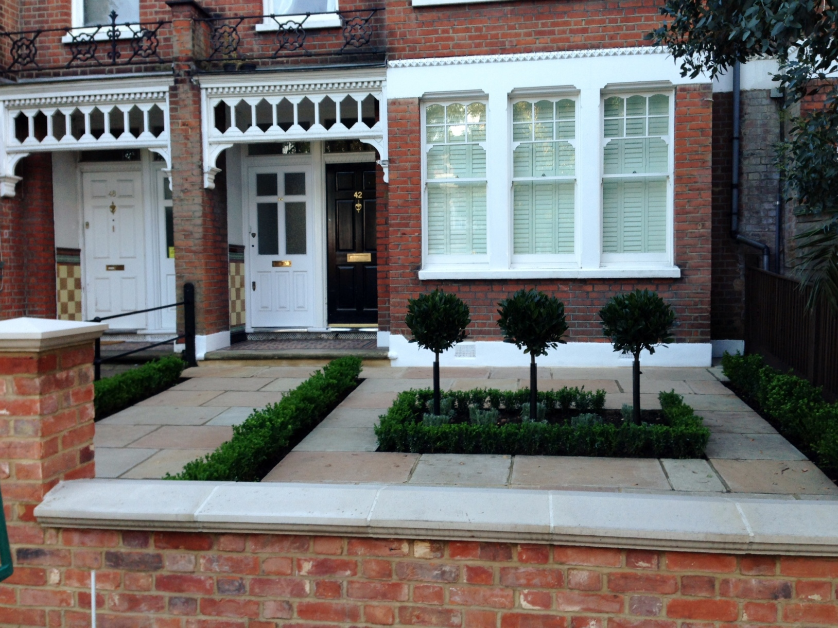 Imperial red brick London wall stone  pier caps sandstone paving and formal topiary classic front garden Balham (14)