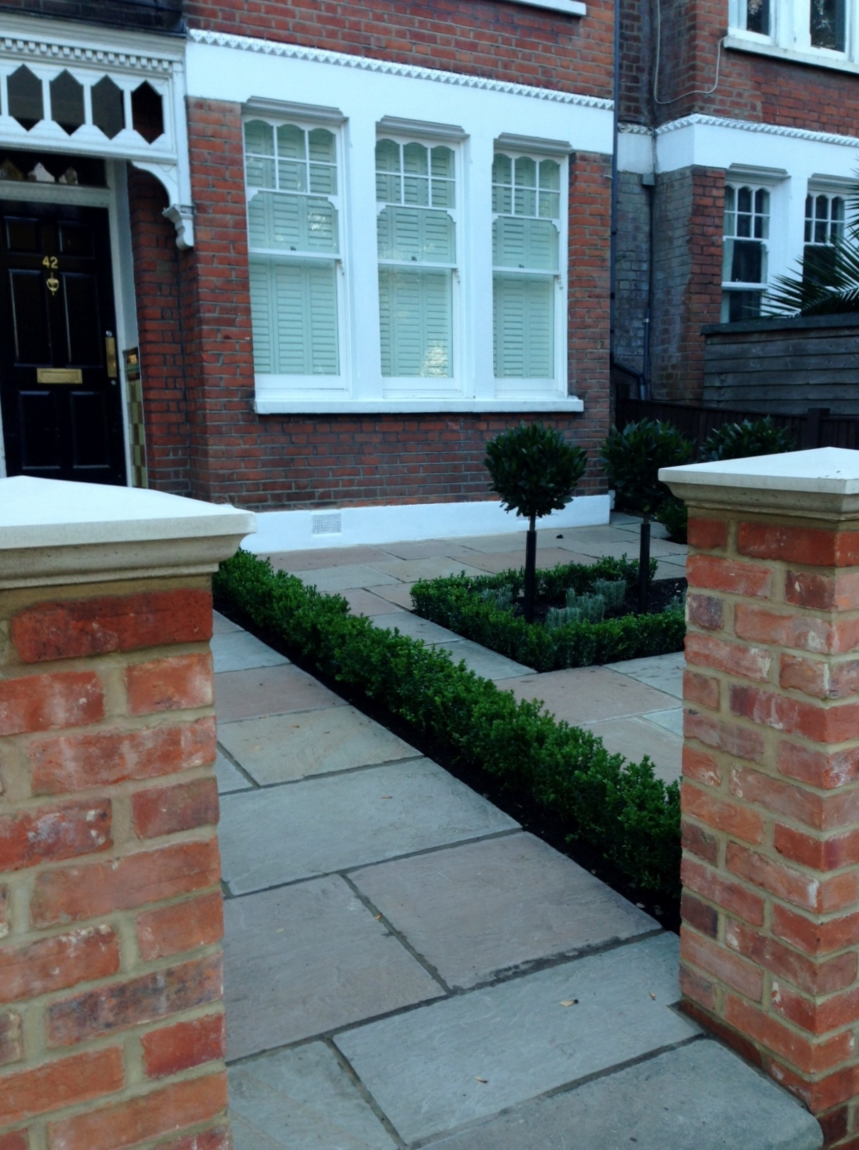 Imperial red brick London wall stone pier caps sandstone paving and formal topiary classic front garden Balham (2)
