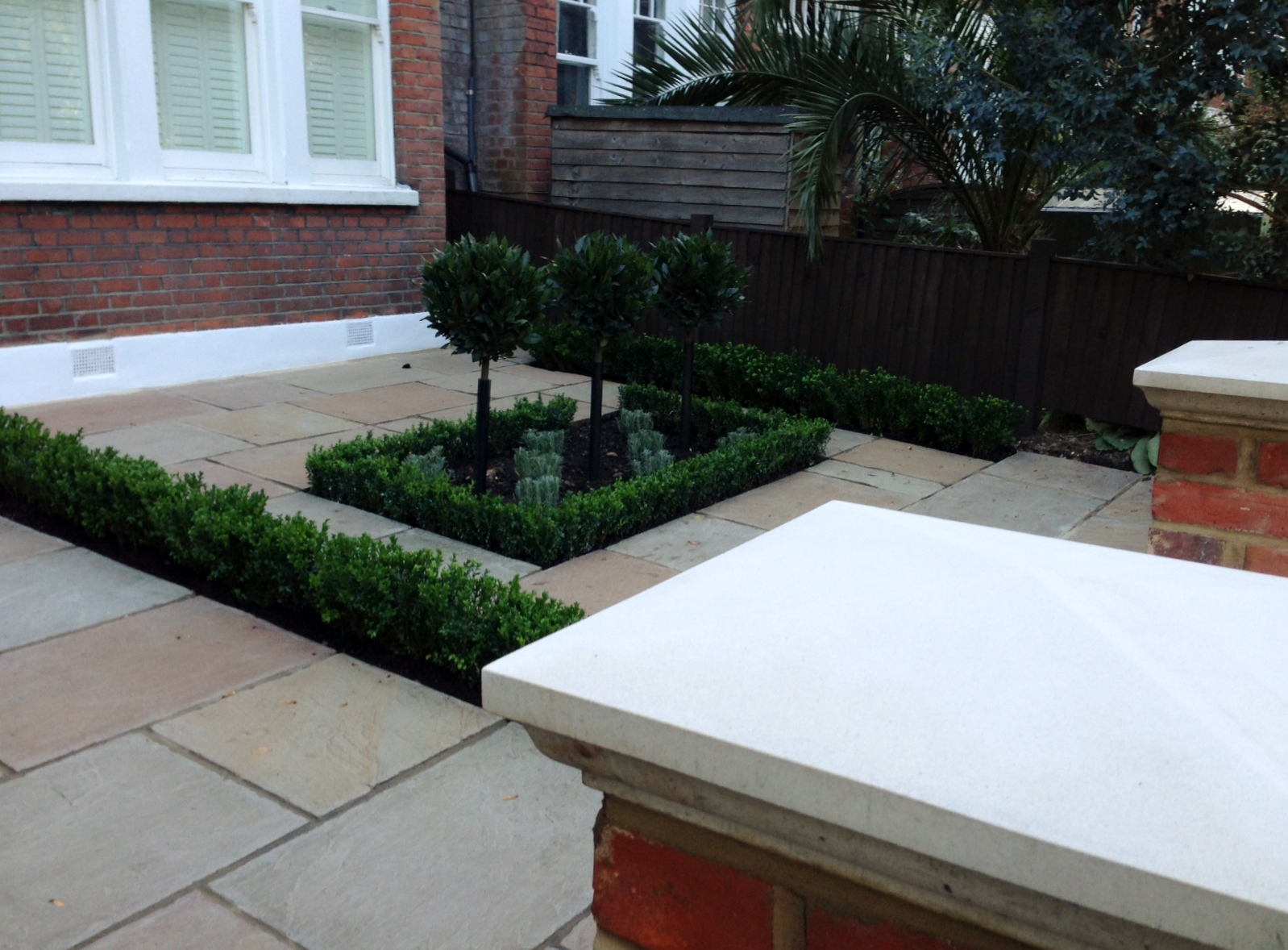 Imperial red brick London wall stone  pier caps sandstone paving and formal topiary classic front garden Balham (7)