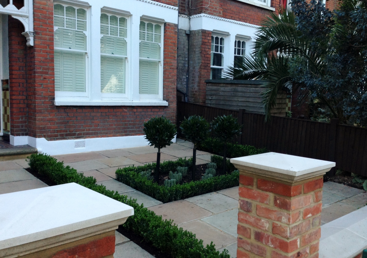 Imperial red brick London wall stone pier caps sandstone paving and formal topiary classic front garden Balham (9)