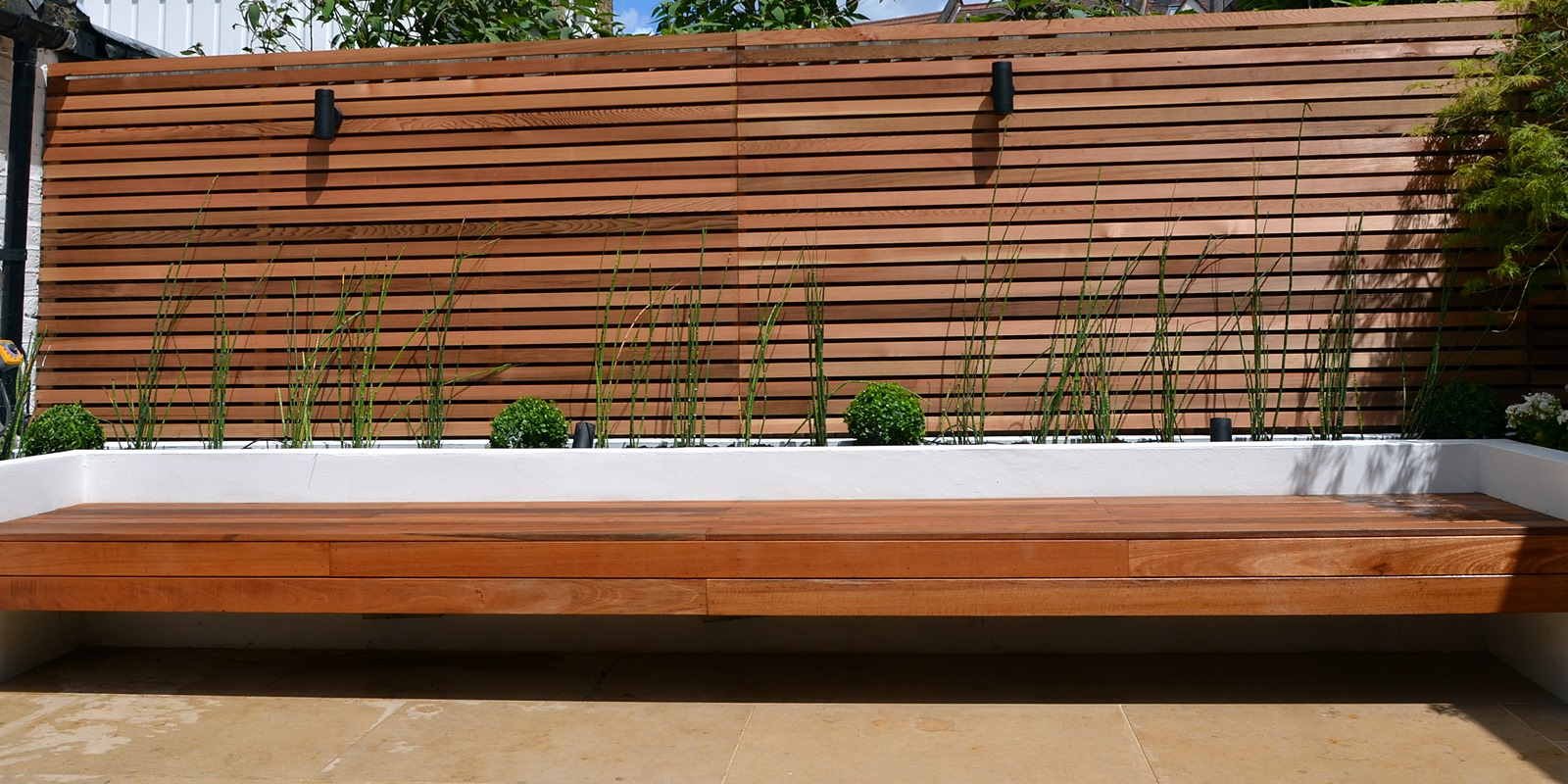cedar screen raised planter bed limestone paving hardwood bench clapham london (1)