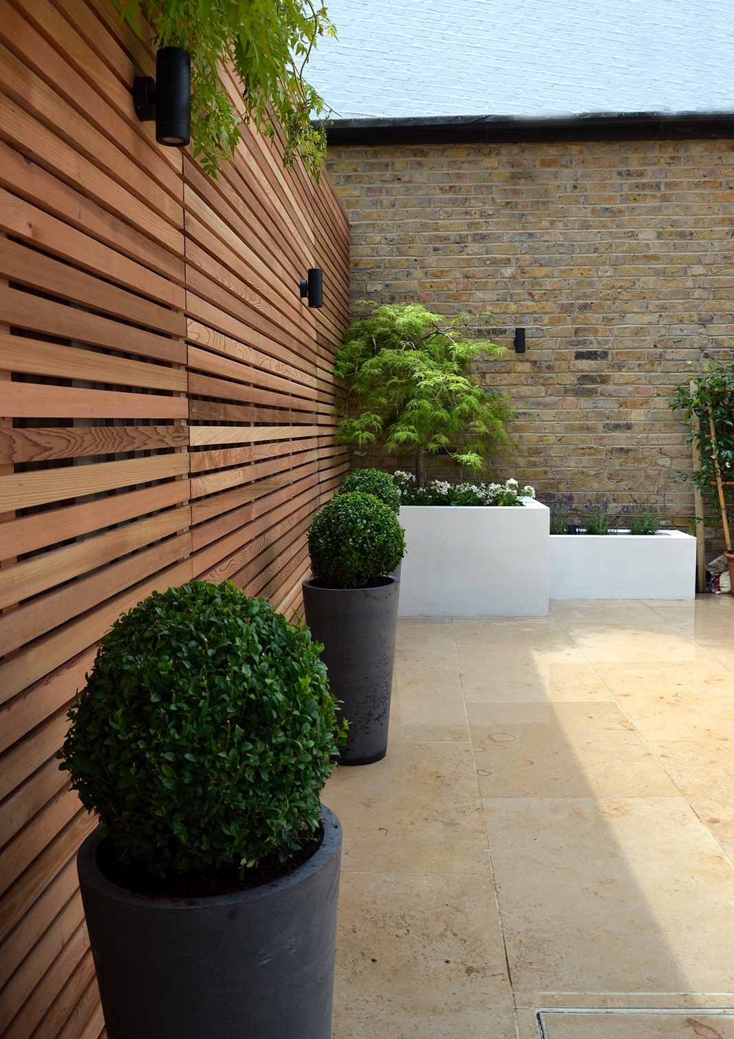 cedar screen raised planter bed limestone paving hardwood bench clapham london (2)