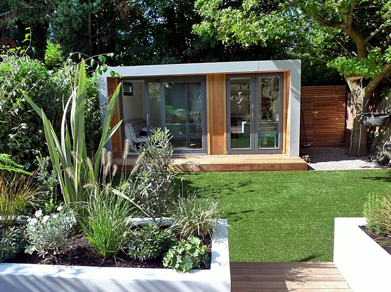 clapham and balham modern garden design decking planting artificial lawn grass hardwood privacy screen indoor outdoor space (11)