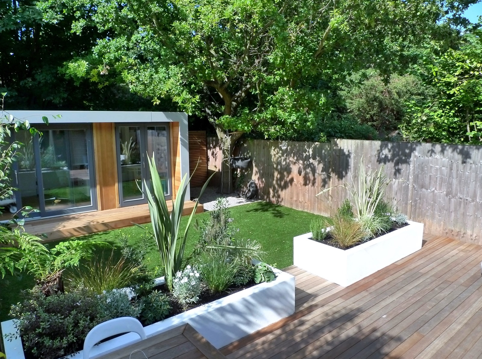 clapham and balham modern garden design decking planting artificial lawn grass hardwood privacy