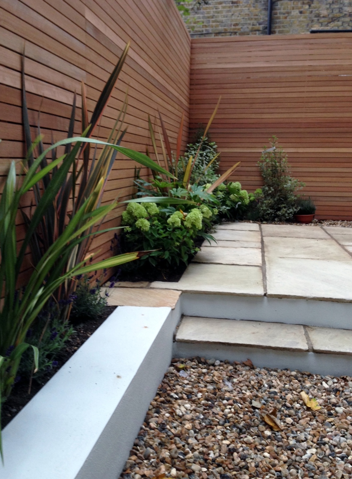 Clapham london garden design sandstone paving hardwood for Modern low maintenance garden ideas