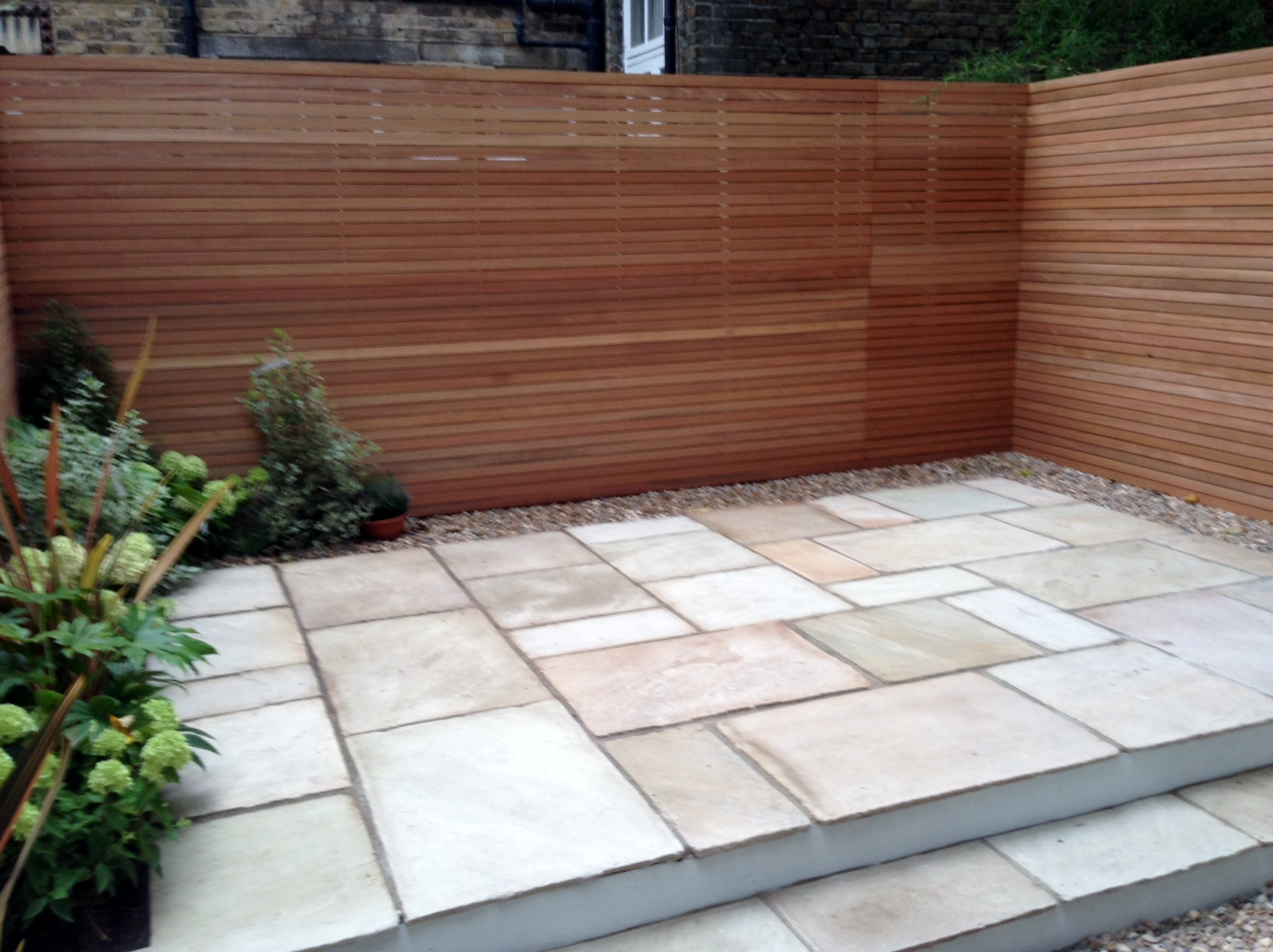 clapham garden design sandstone paving hardwood privacy screen shingle trellis fence modern low maintenance ideas (10)
