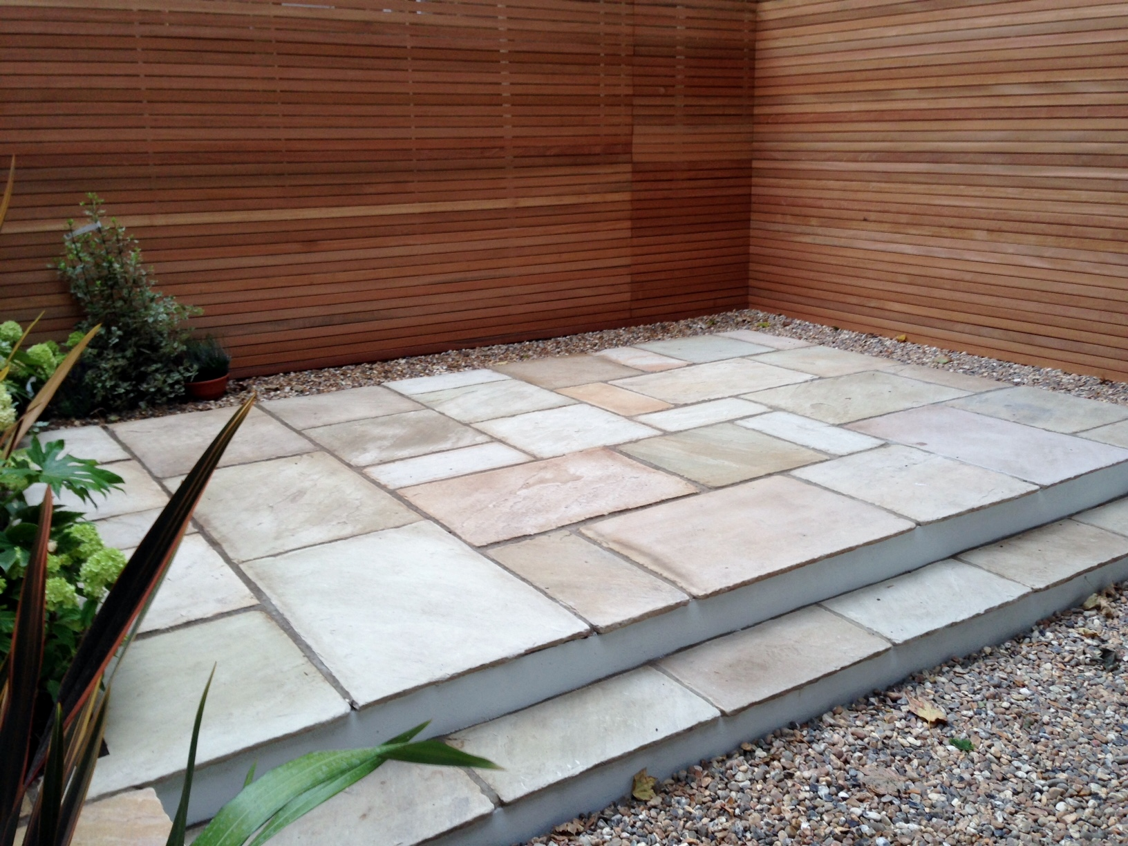 clapham garden design sandstone paving hardwood privacy screen shingle trellis fence modern low maintenance ideas (12)