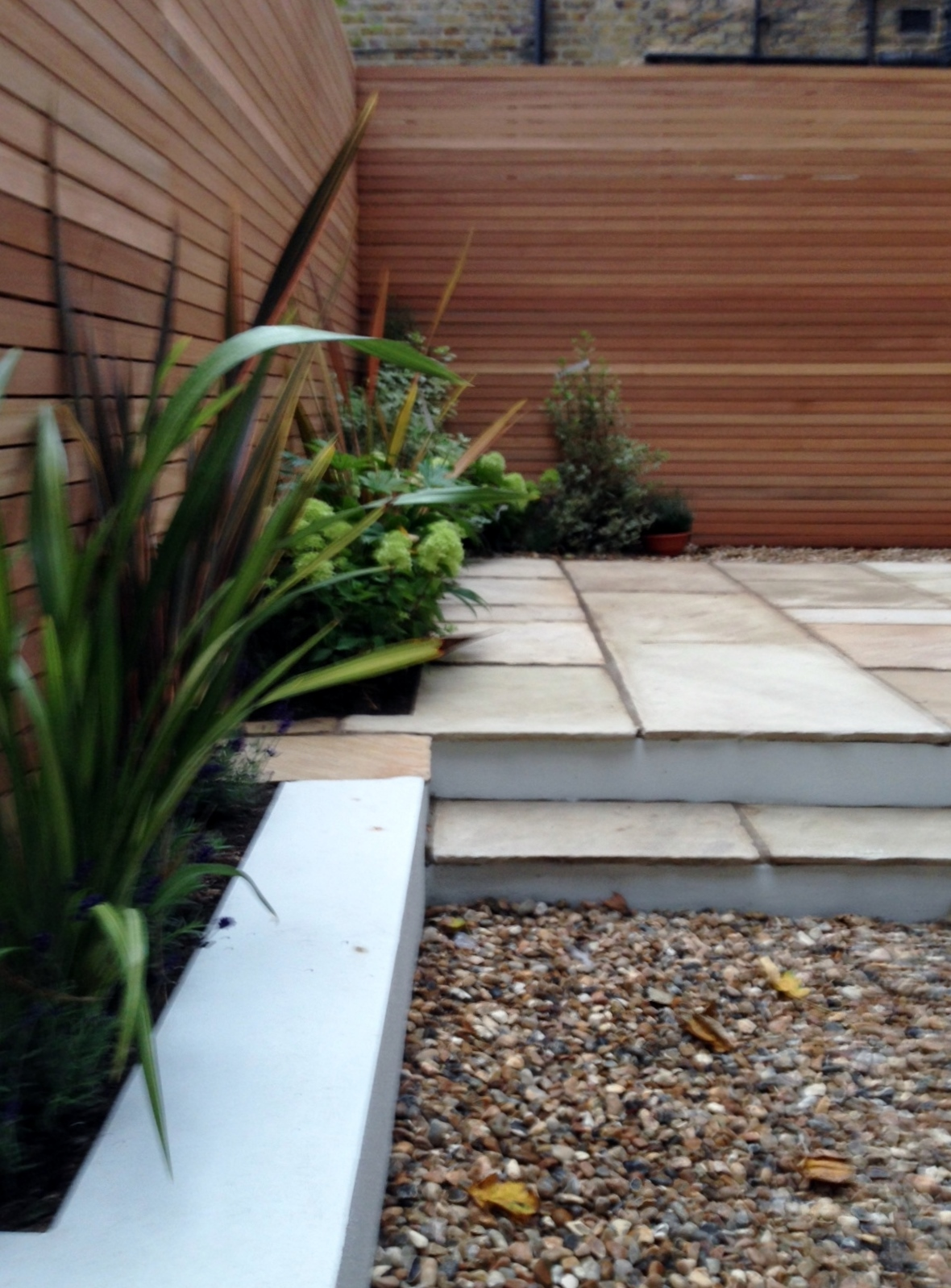 clapham garden design sandstone paving hardwood privacy screen shingle trellis fence modern low maintenance ideas (4)
