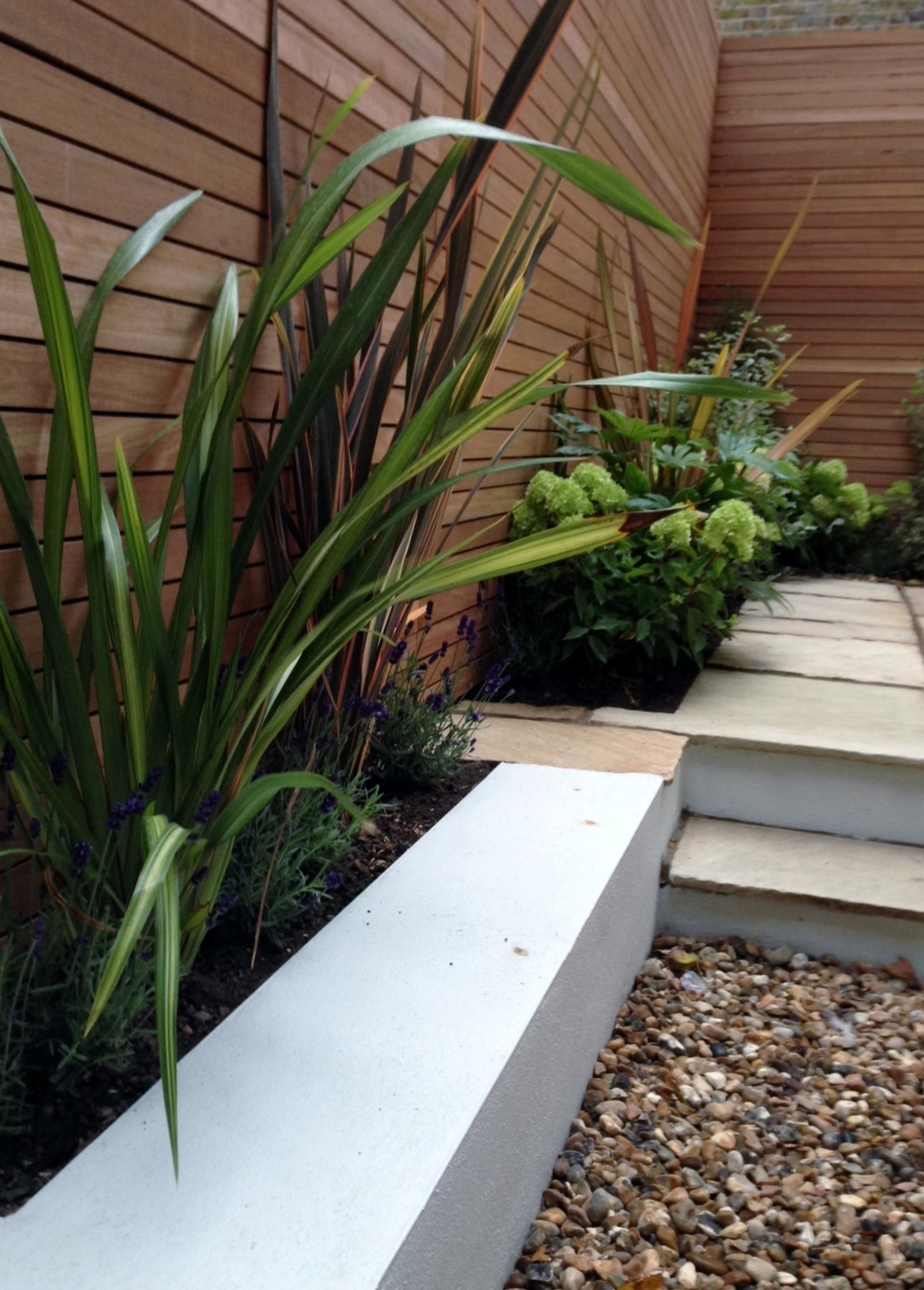 clapham garden design sandstone paving hardwood privacy screen shingle trellis fence modern low maintenance ideas (5)