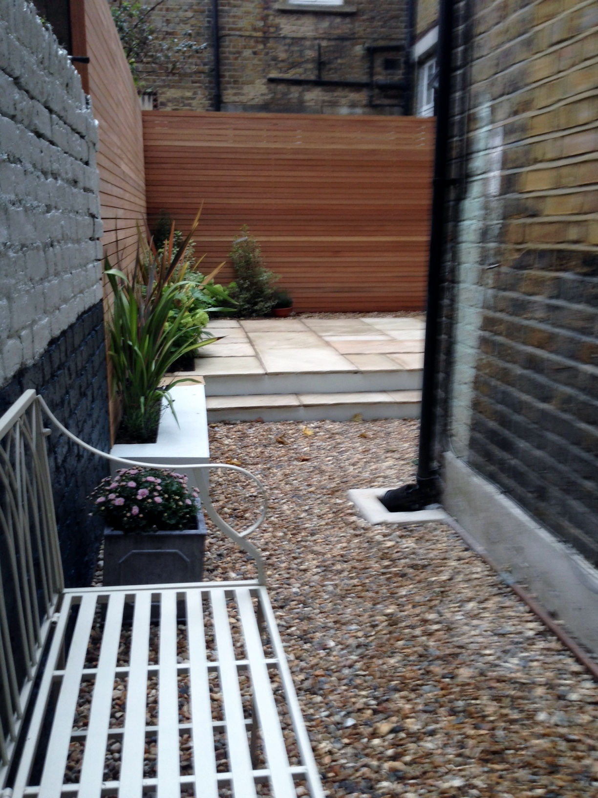 clapham garden design sandstone paving hardwood privacy screen shingle trellis fence modern low maintenance ideas (8)