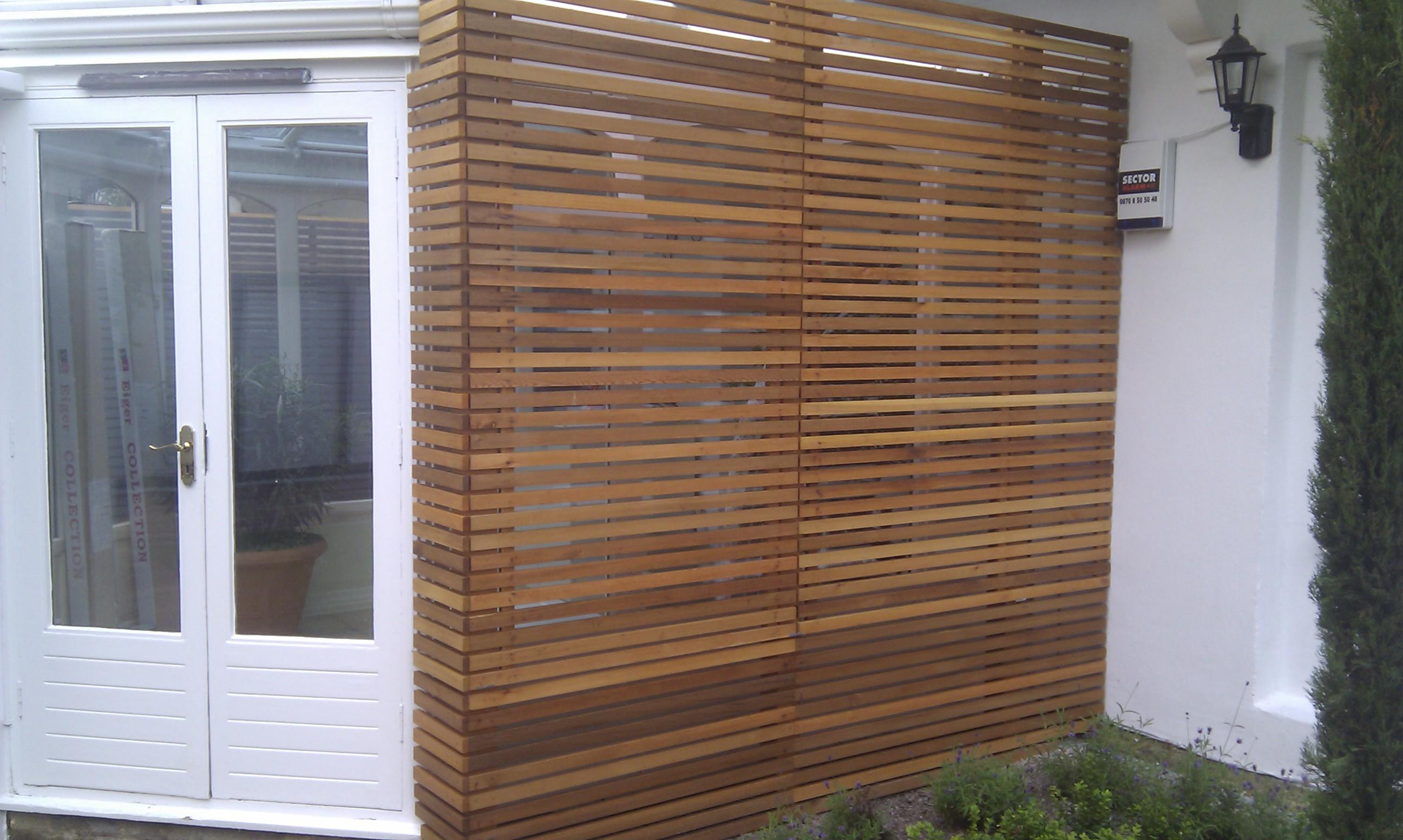 modern garden design london slatted grey privacy screen sandstone paving easy grass balau hardwood decking (21)