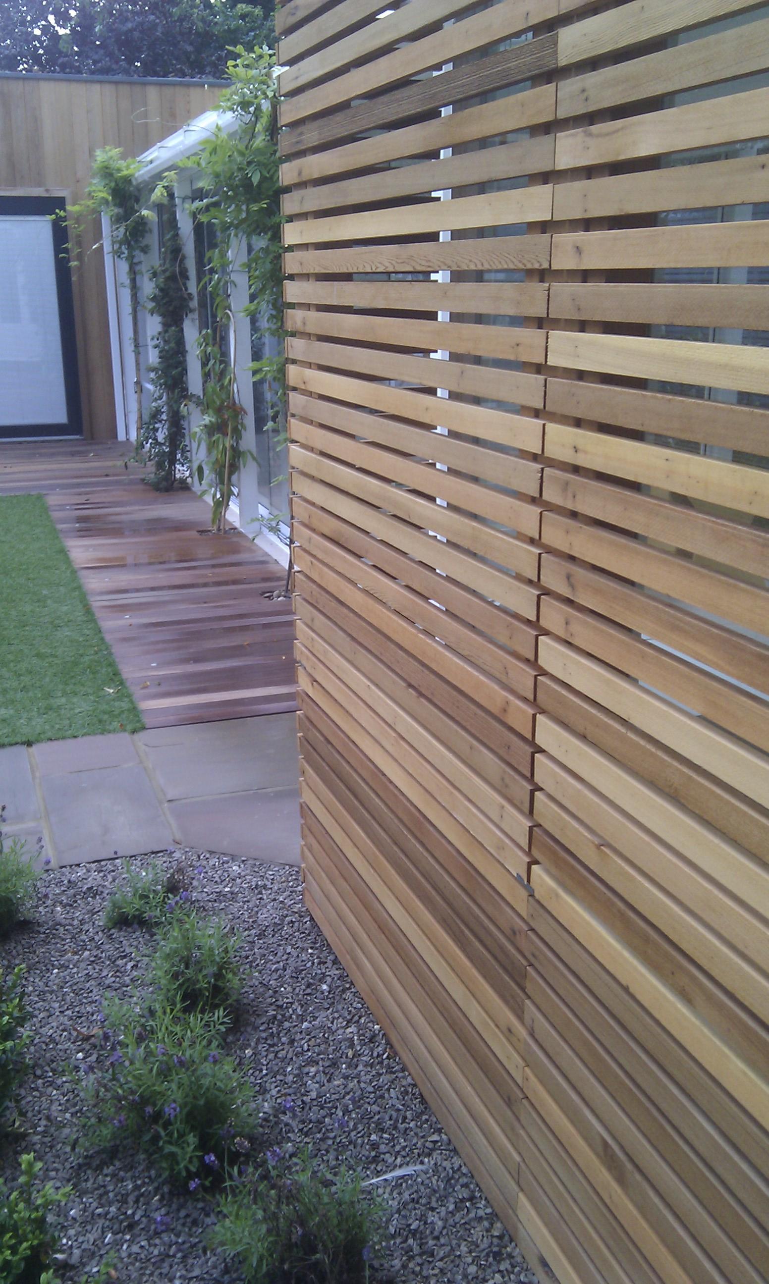 modern garden design london slatted grey privacy screen sandstone paving easy grass balau hardwood decking (23)