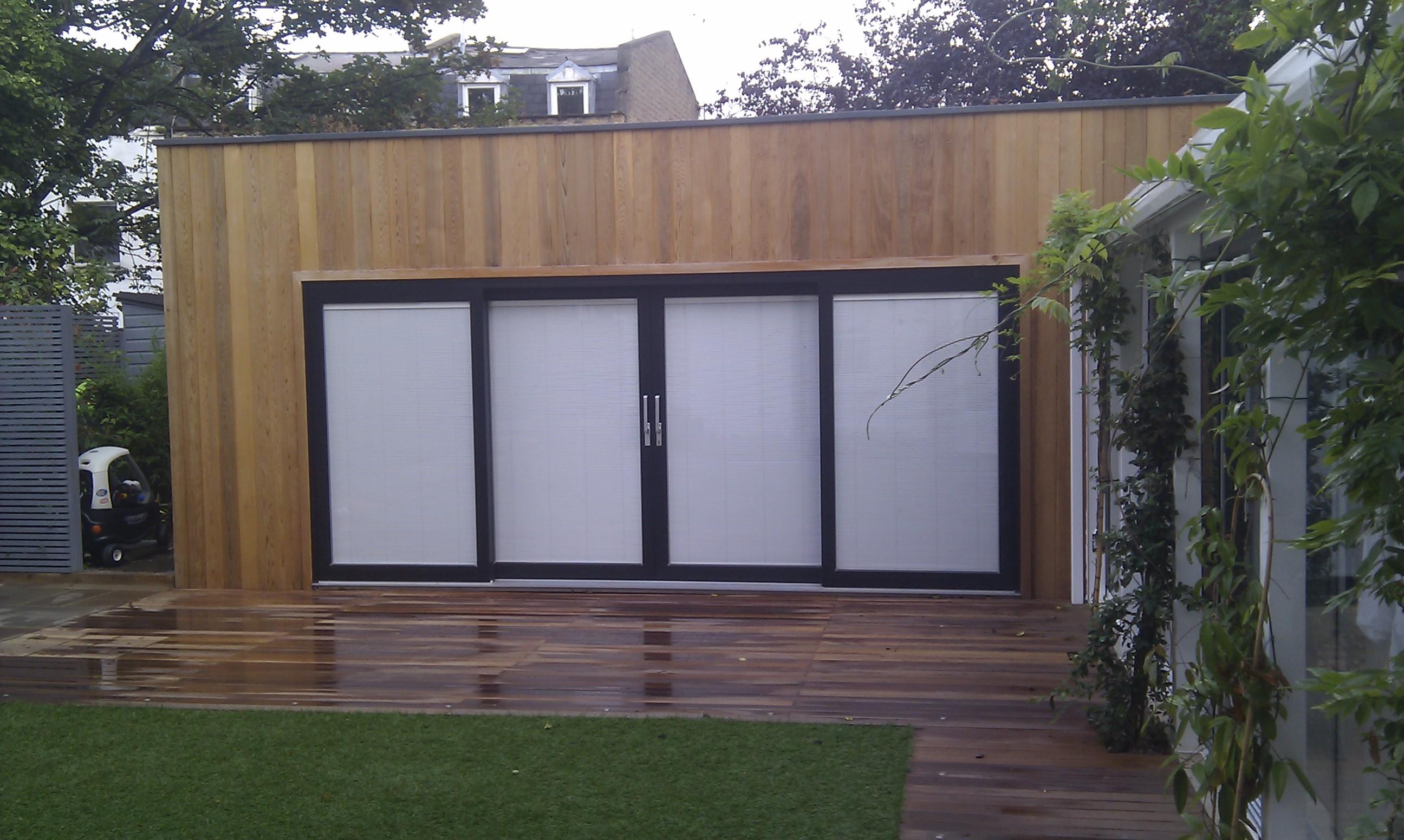 modern garden design london slatted grey privacy screen sandstone paving easy grass balau hardwood decking (36)