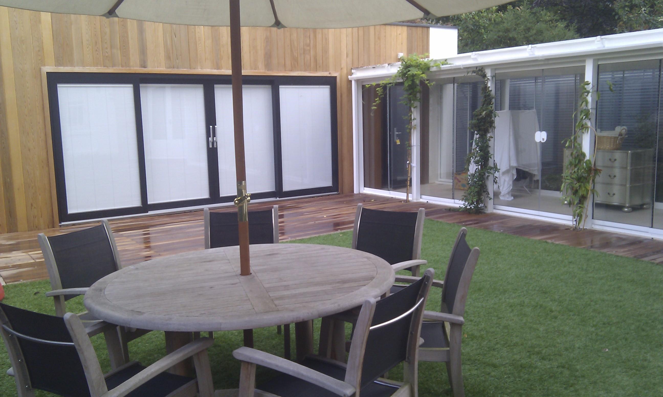 modern garden design london slatted grey privacy screen sandstone paving easy grass balau hardwood decking (38)