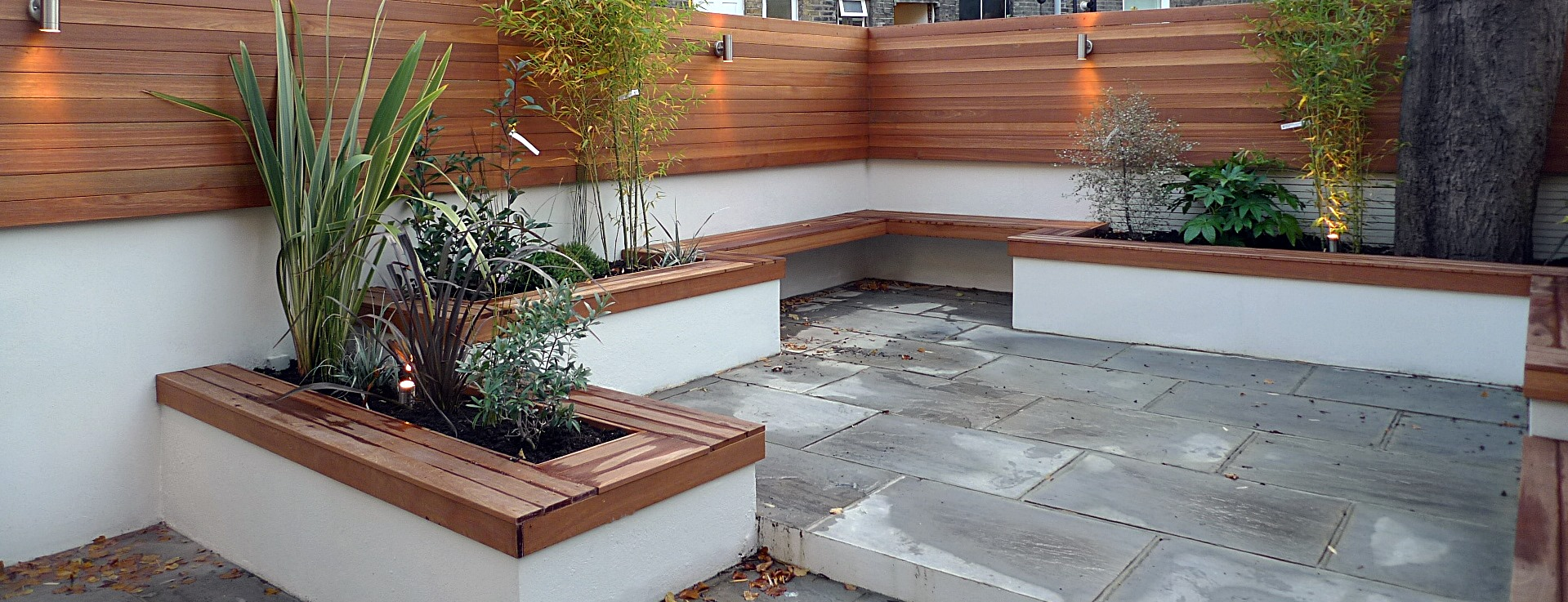 modern london courtyard low maintenance urban outdoor indoor living garden space paving screens planting bench raised beds (10)