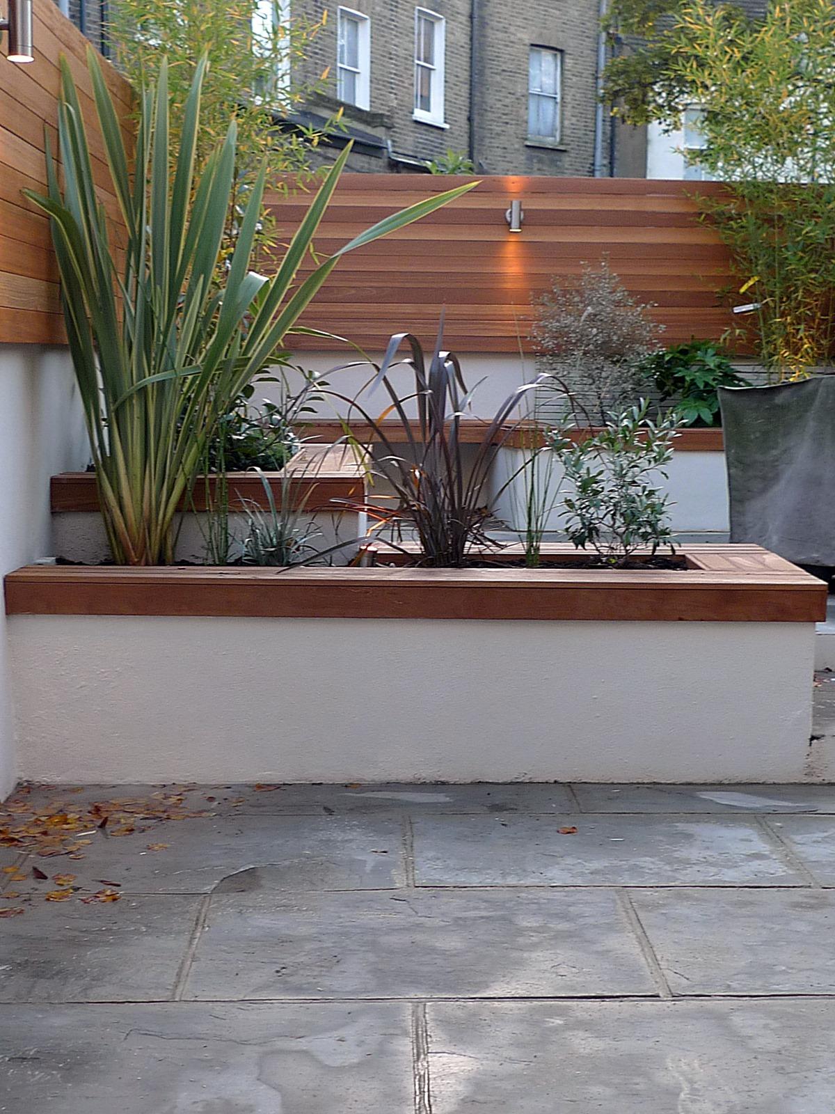 modern london courtyard low maintenance urban outdoor indoor living garden space paving screens planting bench raised beds (3)