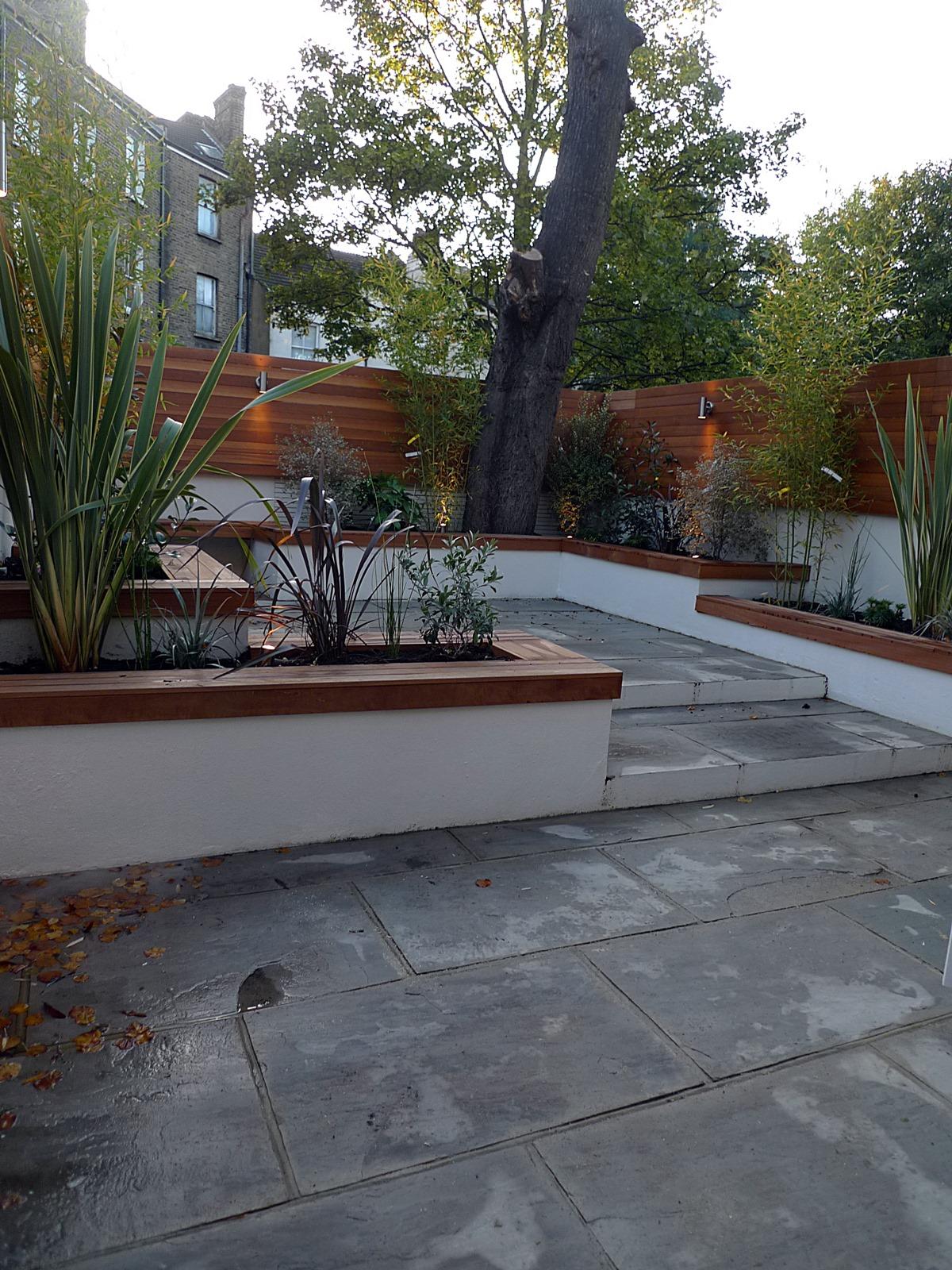 modern london courtyard low maintenance urban outdoor indoor living garden space paving screens planting bench raised beds (4)