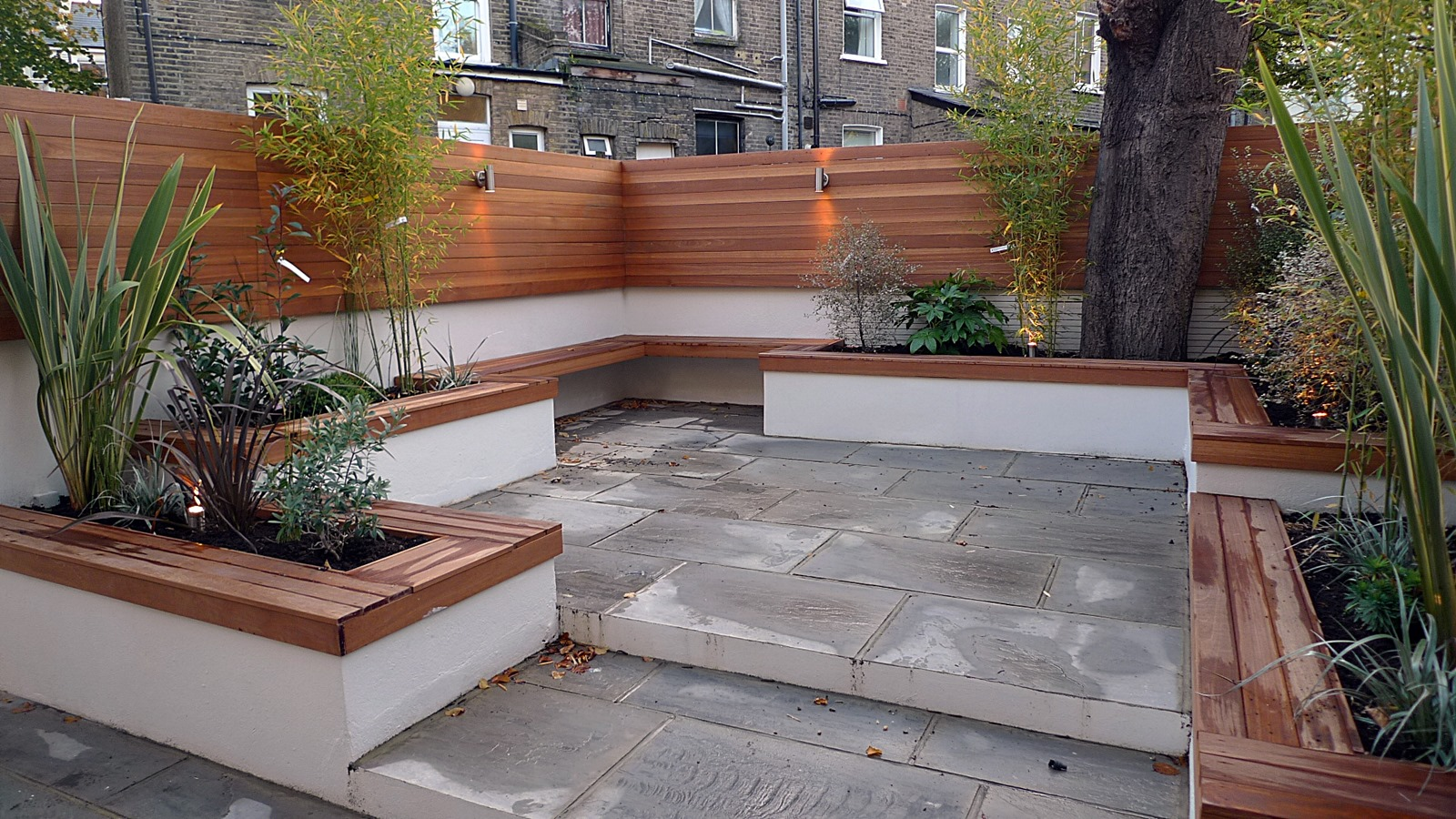 modern london courtyard low maintenance urban outdoor indoor living garden space paving screens planting bench raised beds (7)
