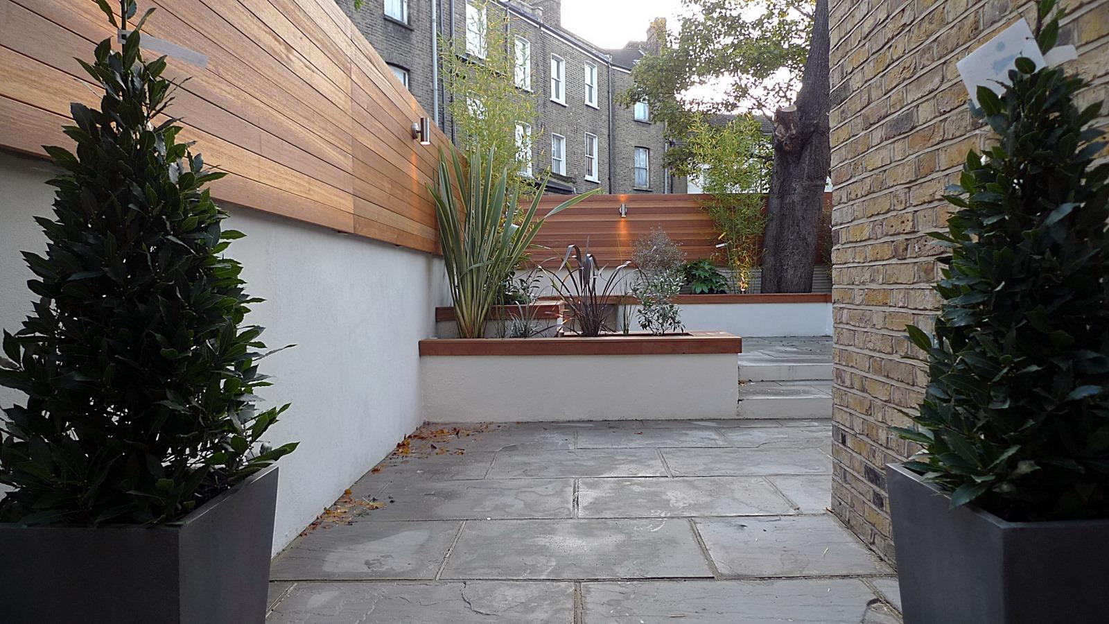 modern london courtyard low maintenance urban outdoor indoor living garden space paving screens planting bench raised beds (8)