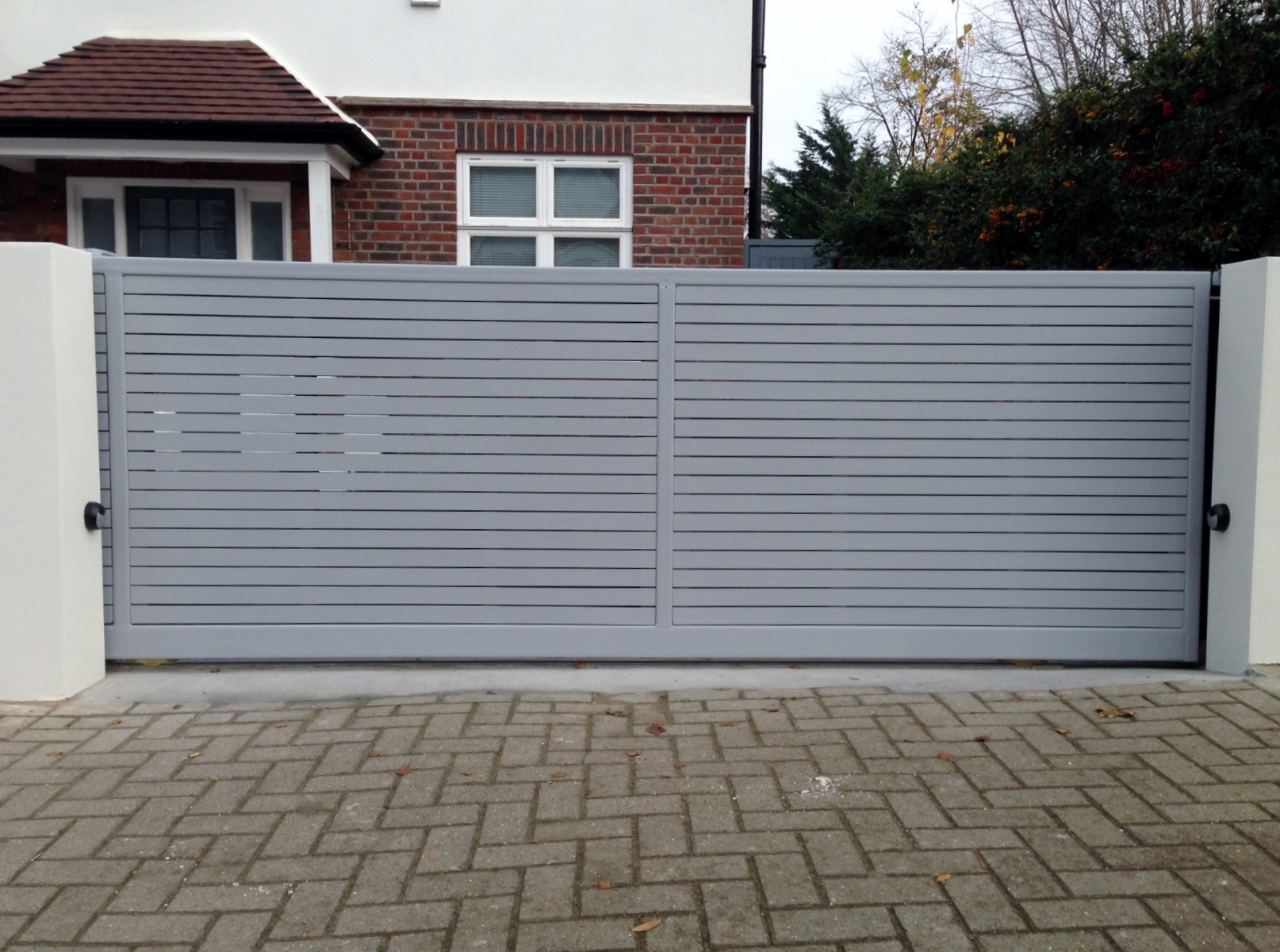 front boundary wall screen automated electronic gate installation grey wooden fence bike store modern garden design balham clapham london (10)