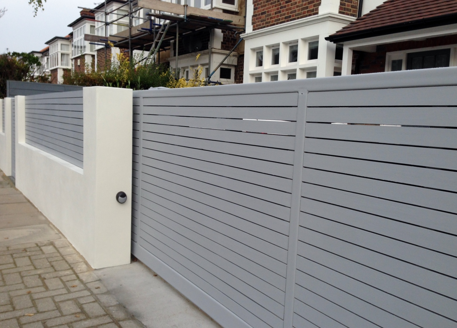 front boundary wall screen automated electronic gate installation grey wooden fence bike store modern garden design balham clapham london (11)