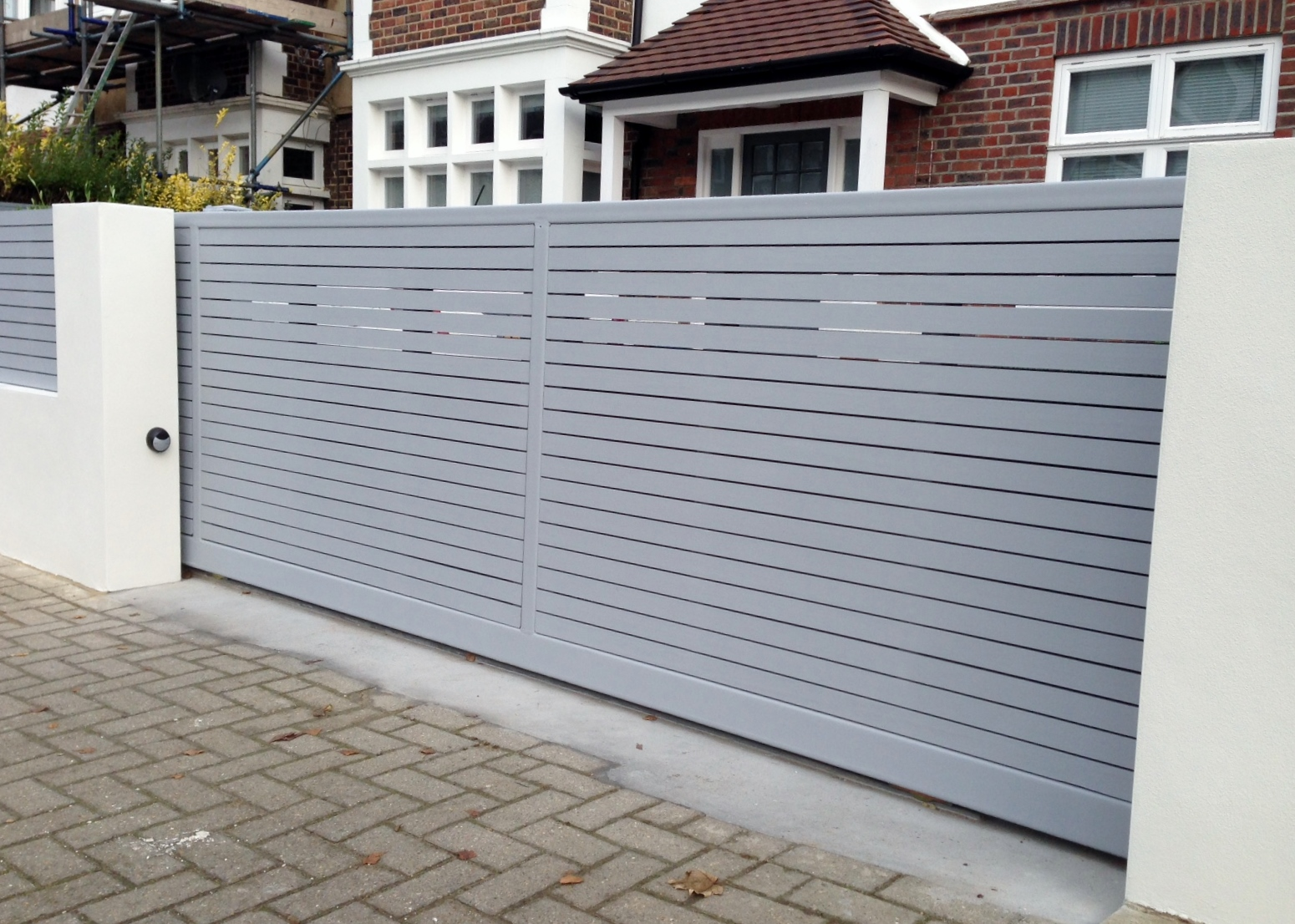 front boundary wall screen automated electronic gate installation grey wooden fence bike store modern garden design balham clapham london (12)