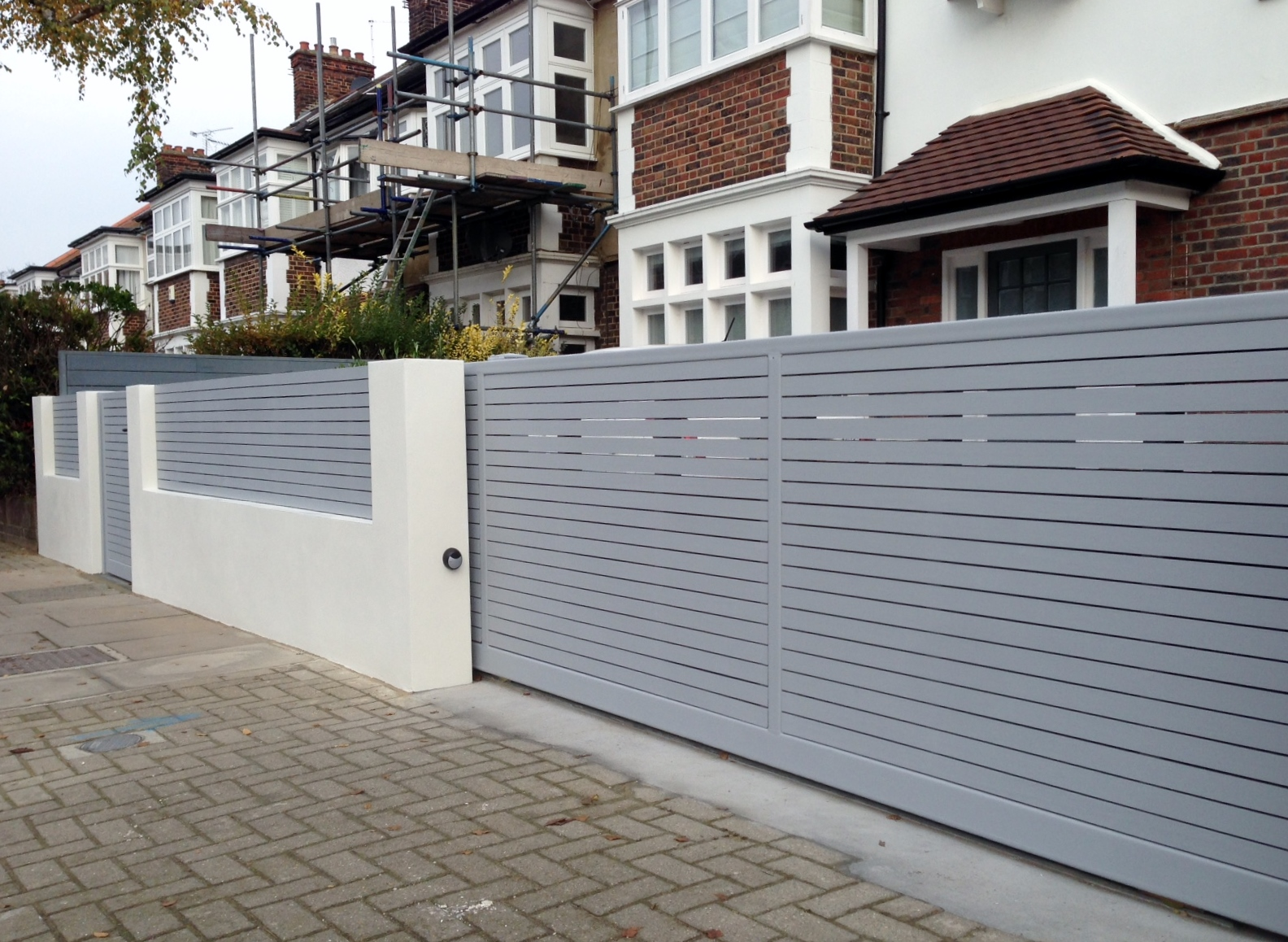 front boundary wall screen automated electronic gate installation grey wooden fence bike store modern garden design balham clapham london (13)