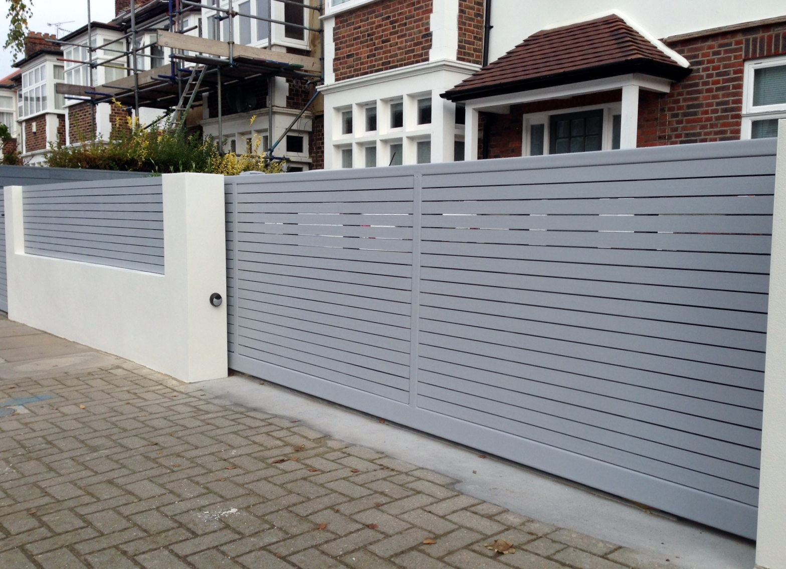 front boundary wall screen automated electronic gate installation grey wooden fence bike store modern garden design balham clapham london (14)