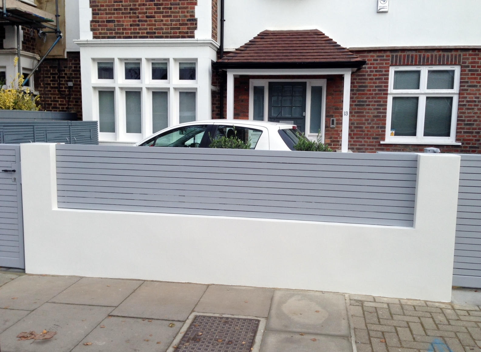 front boundary wall screen automated electronic gate installation grey wooden fence bike store modern garden design balham clapham london (15)
