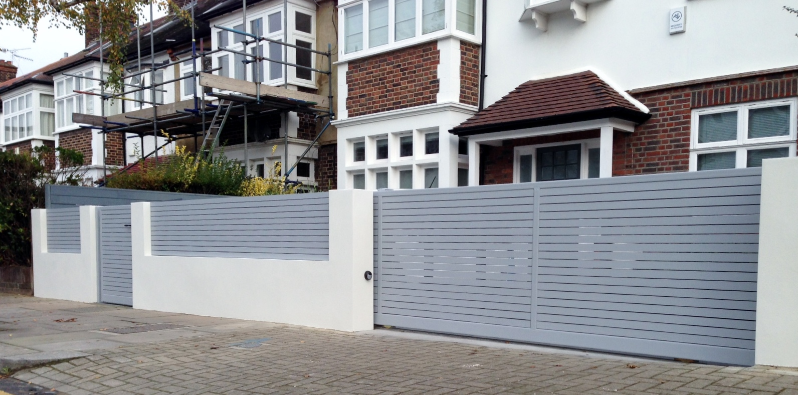 front boundary wall screen automated electronic gate installation grey wooden fence bike store modern garden design balham clapham london (17)