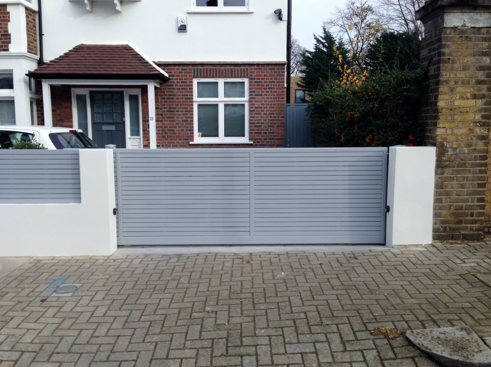 front boundary wall screen automated electronic gate installation grey wooden fence bike store modern garden design balham clapham london (18)