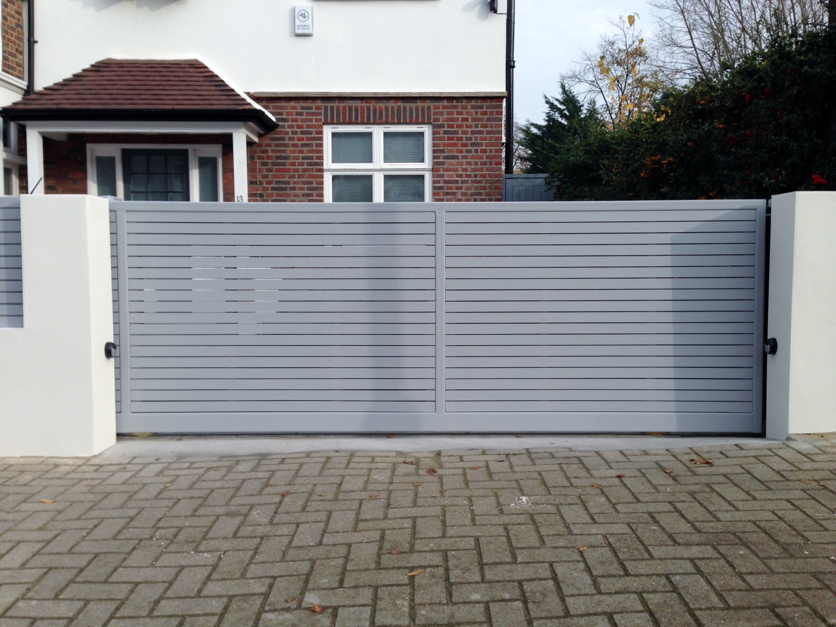 front boundary wall screen automated electronic gate installation grey wooden fence bike store modern garden design balham clapham london (19)