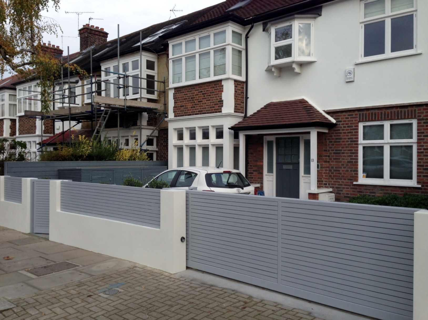 front boundary wall screen automated electronic gate installation grey wooden fence bike store modern garden design balham clapham london (2)