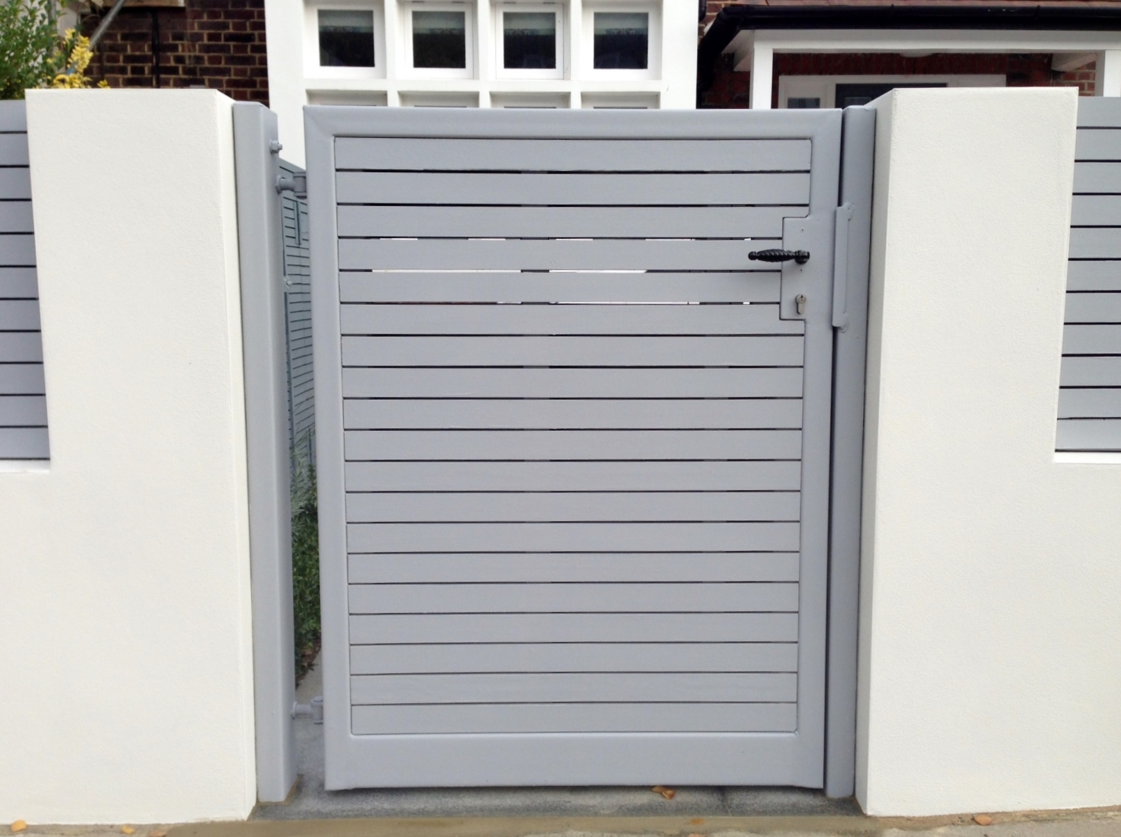 front boundary wall screen automated electronic gate installation grey wooden fence bike store modern garden design balham clapham london (5)