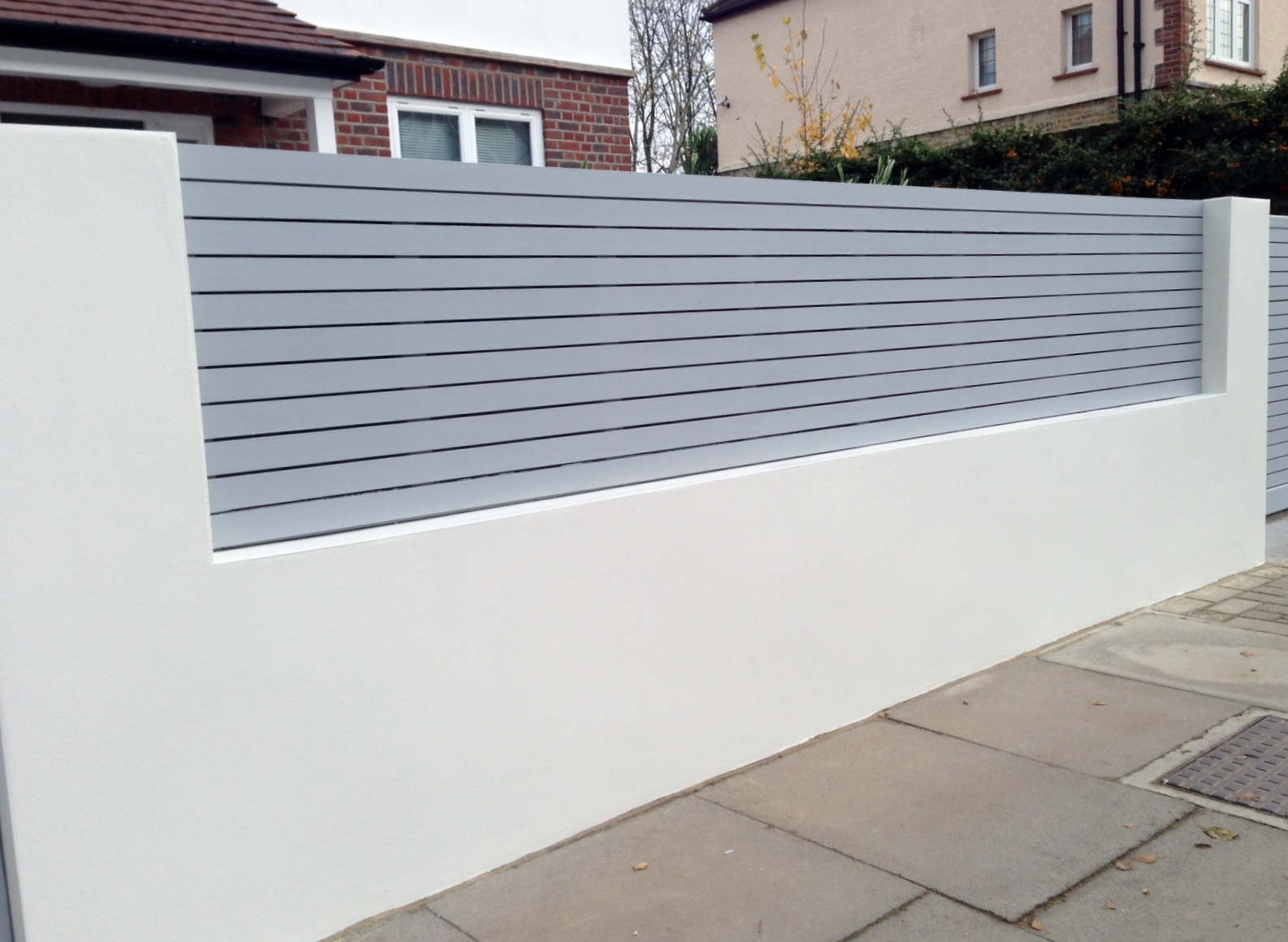 front boundary wall screen automated electronic gate installation grey wooden fence bike store modern garden design balham clapham london (6)