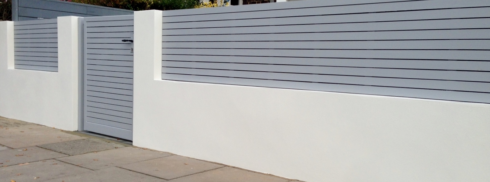 front boundary wall screen automated electronic gate installation grey wooden fence bike store modern garden design balham clapham london (8)